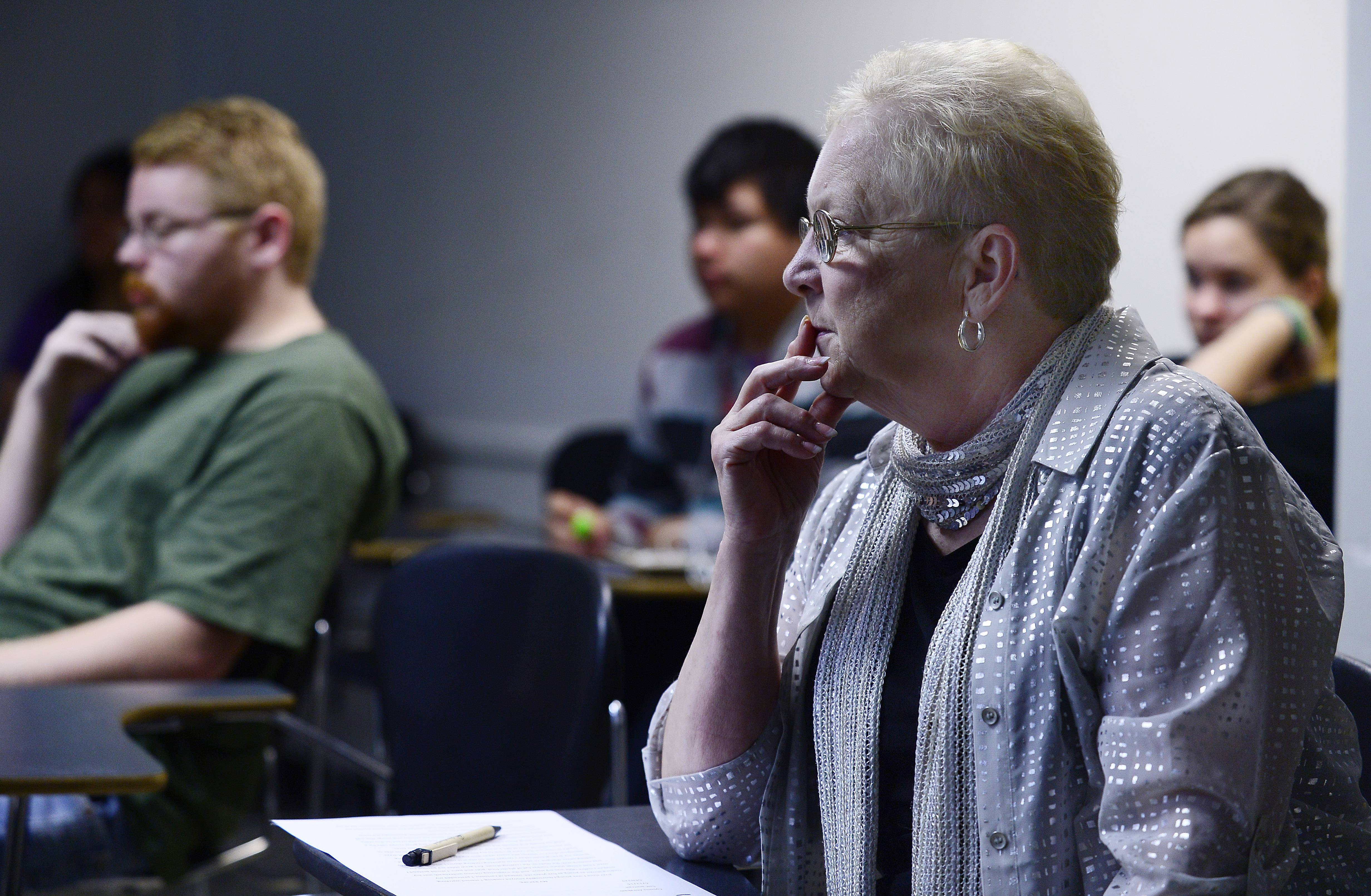 Teacher Diane Kostick of the Illinois Institute of Art in Schaumburg, and formerly of Barrington Unit District 220, is celebrating 50 years of continuous teaching this month. Here she looks on as her humanities students present their final projects of the school year.