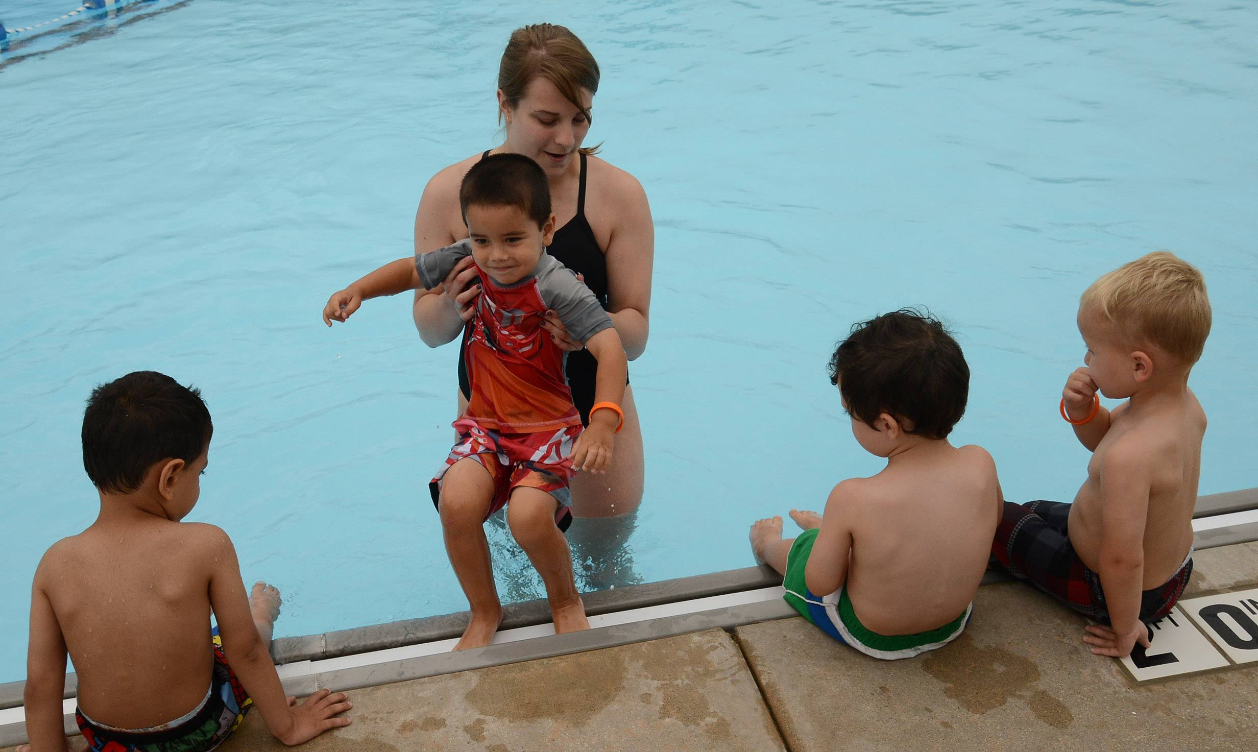 From left, Luke Shamon, Julian Rice, Brady Klevens, and Owen Goodfellow, all 3, and all from Gurnee, get a swim lesson from instructor Haley Brown during The World's Largest Swimming Lesson at the Hunt Club Park Aquatic Center in Gurnee.