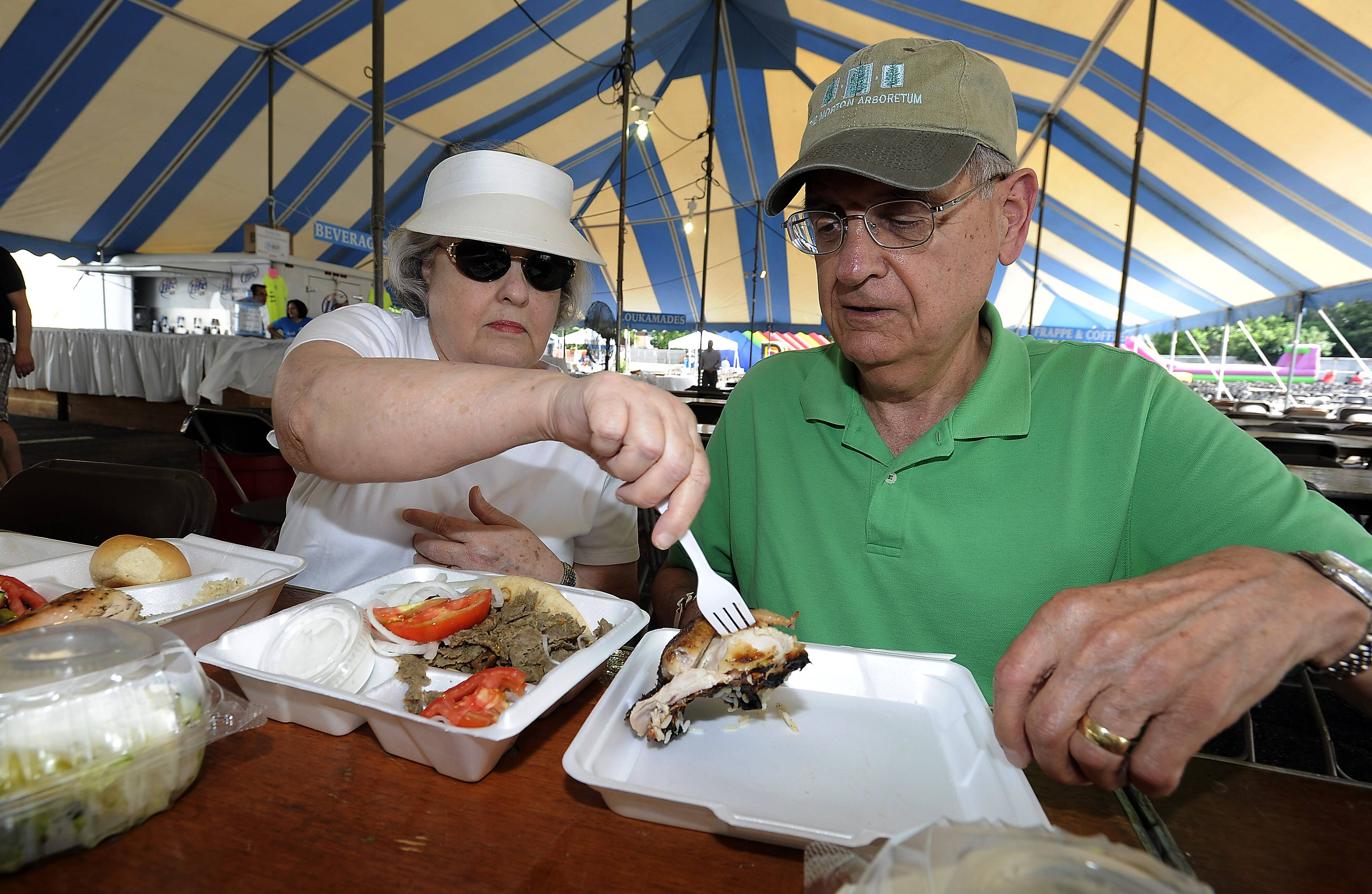 Tom and Gloria Garrison, of Schaumburg, beat the crowd surge and are the first ones in line for the chicken and gyros at the annual St. Nectarios Church Greek Fest in Palatine on Friday.