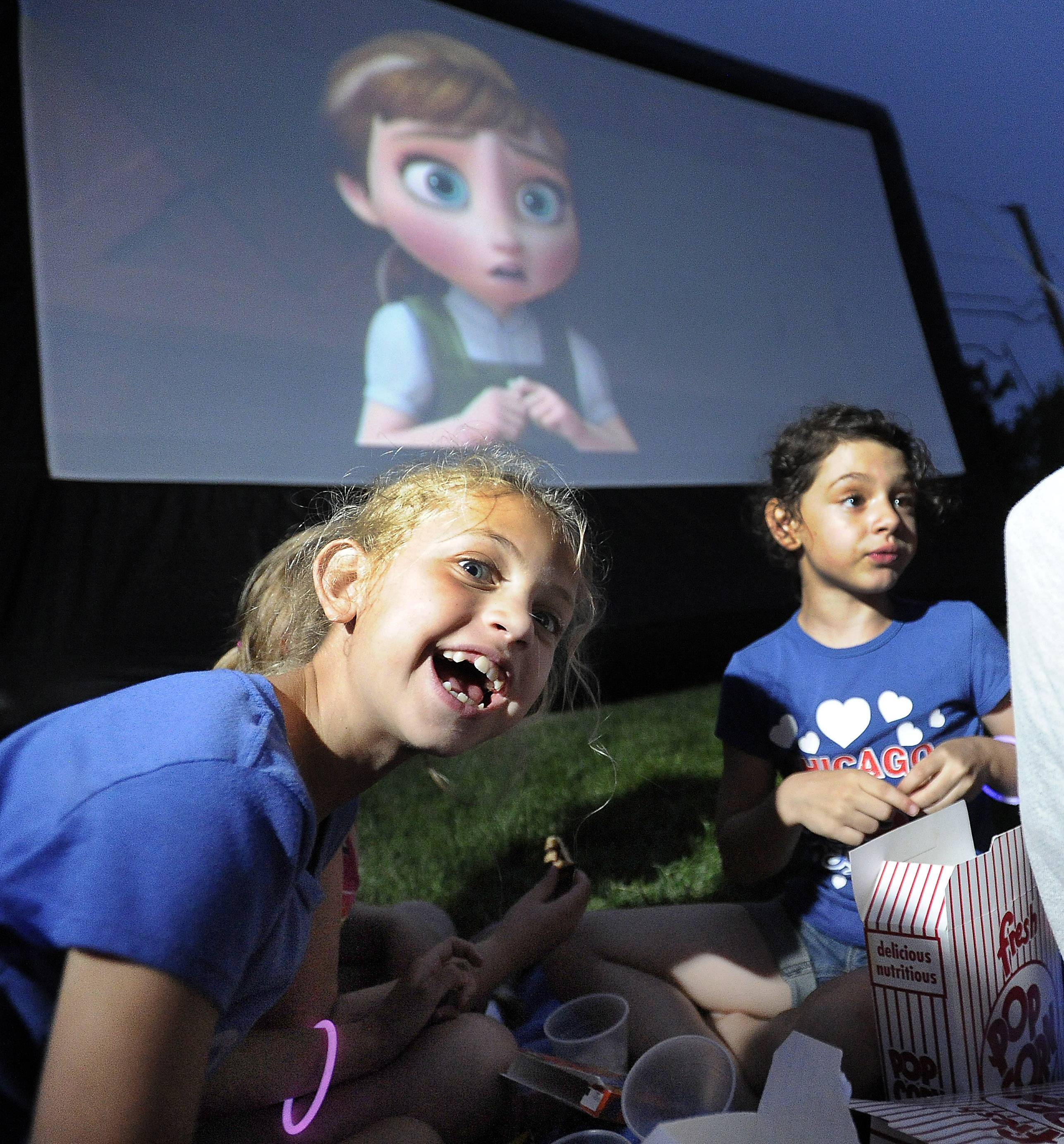 Enjoying Walt Disney's Frozen is Olivia Reed, 8, and her friend Sophia Licato, 7, both of Arlington Heights at Recreation Park in Arlington Heights on Friday.