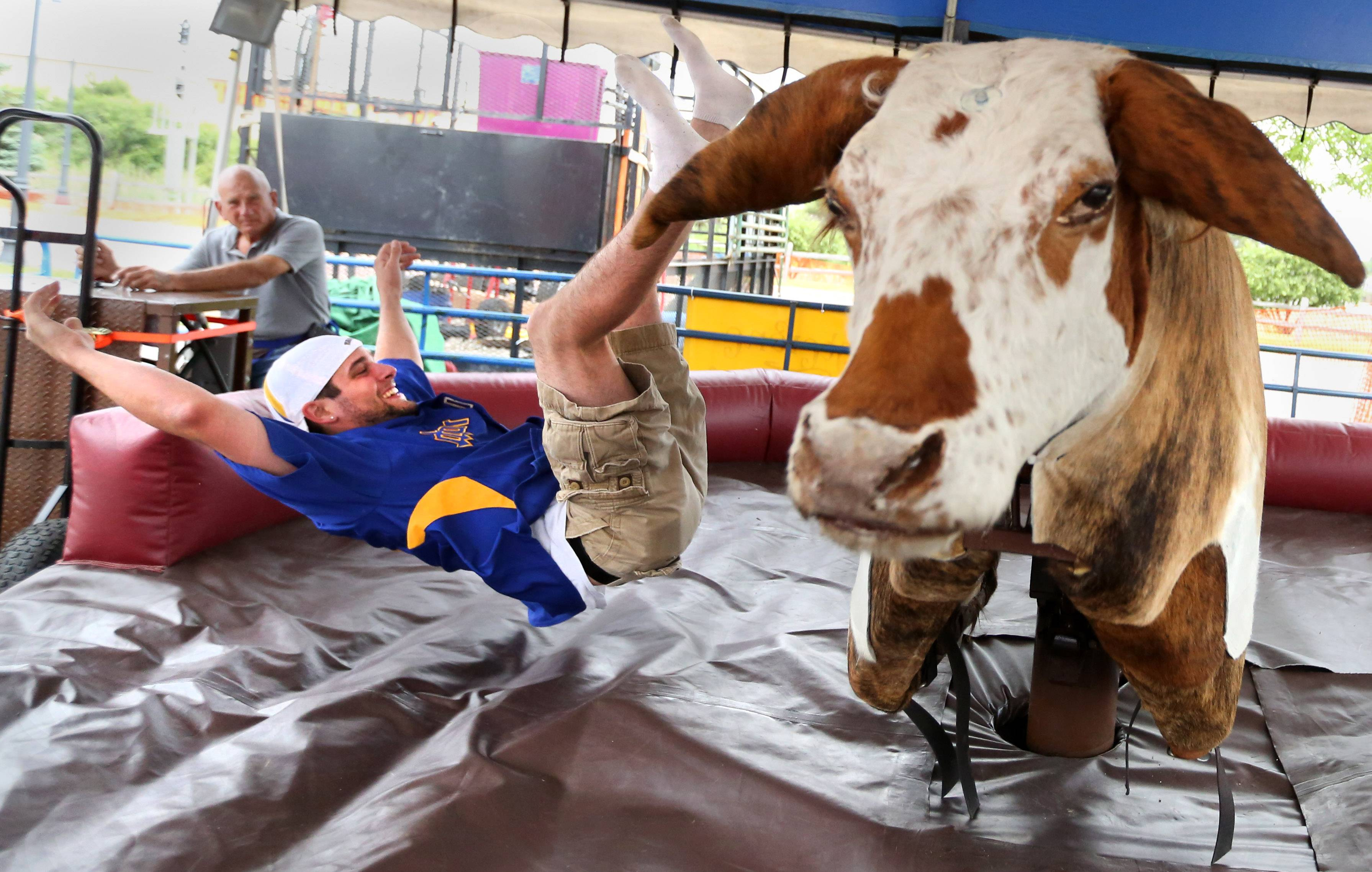 Jason Hanenberger, of Round Lake, bounces up after flying off a mechanical bull and hitting an air padded mat at the second day of Round Lake Beach BeachFest on Saturday at the Cultural & Civic Center.