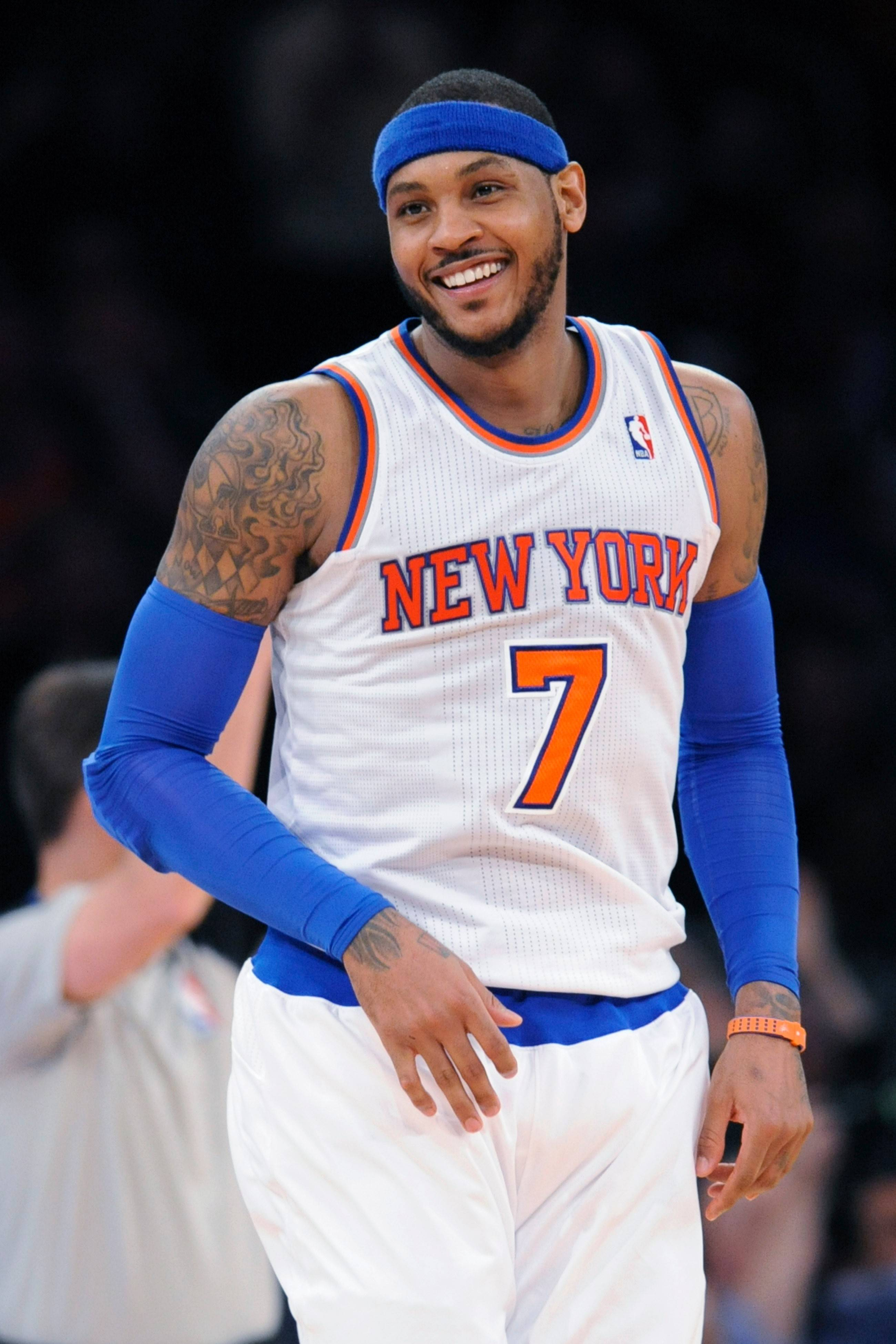 New York Knicks' Carmelo Anthony smiles after hitting a three-point shot during the third quarter of a Jan. 24 NBA basketball game against the Charlotte Bobcats at Madison Square Garden in New York. Anthony scored 62 points as the Knicks won 125-96.