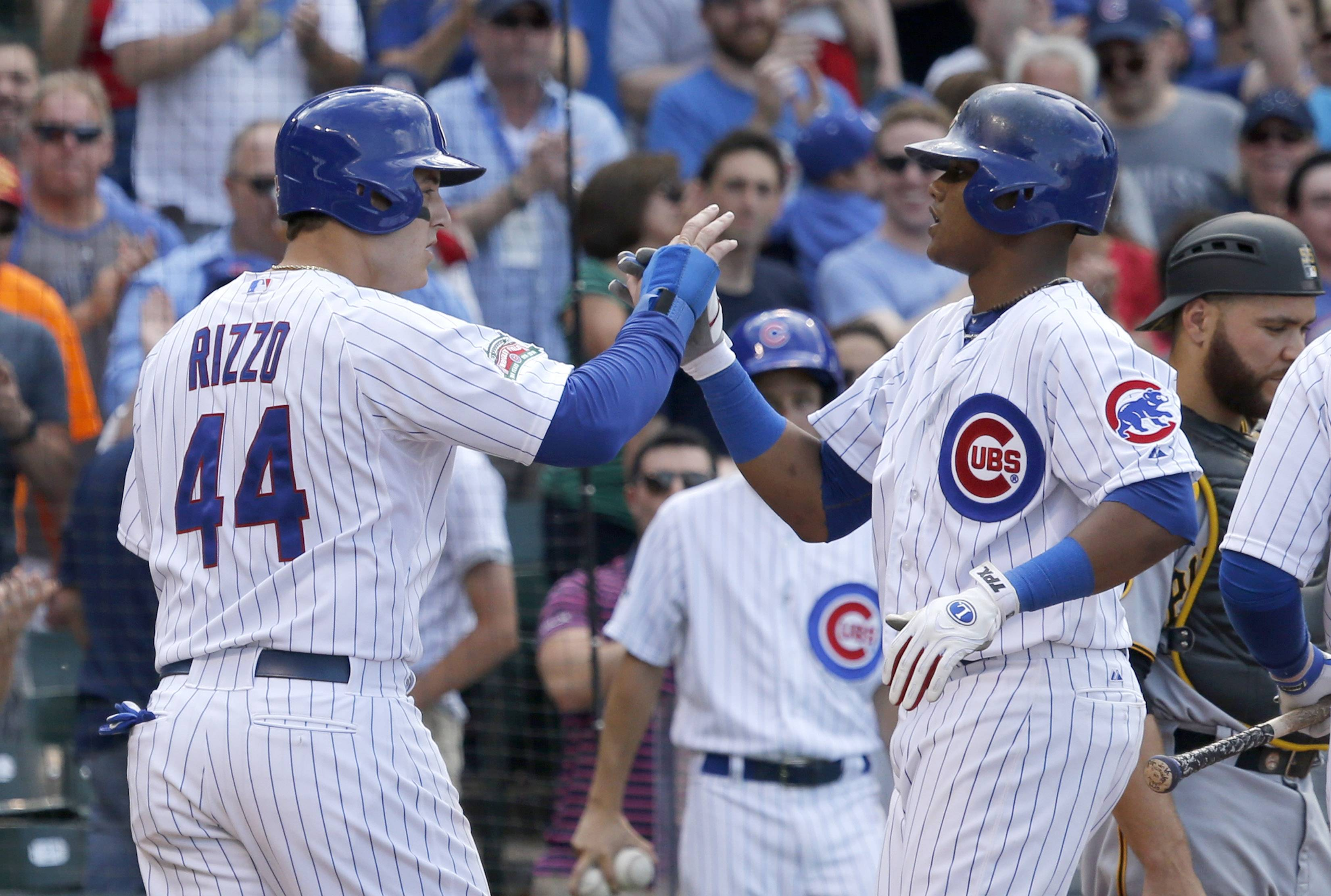 The Chicago Cubs' Starlin Castro, right, celebrates his three-run home run off Pittsburgh Pirates starting pitcher Charlie Morton with teammate Anthony Rizzo during the third inning of a baseball game on Friday, June 20, 2014, in Chicago. Rizzo and Chris Coghlan also scored on the hit.