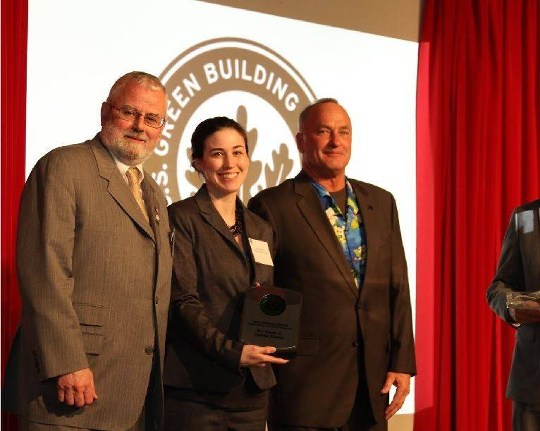 Mayor Bill McLeod, left, accepts Emerald Award at USGBC Limelight event in May.
