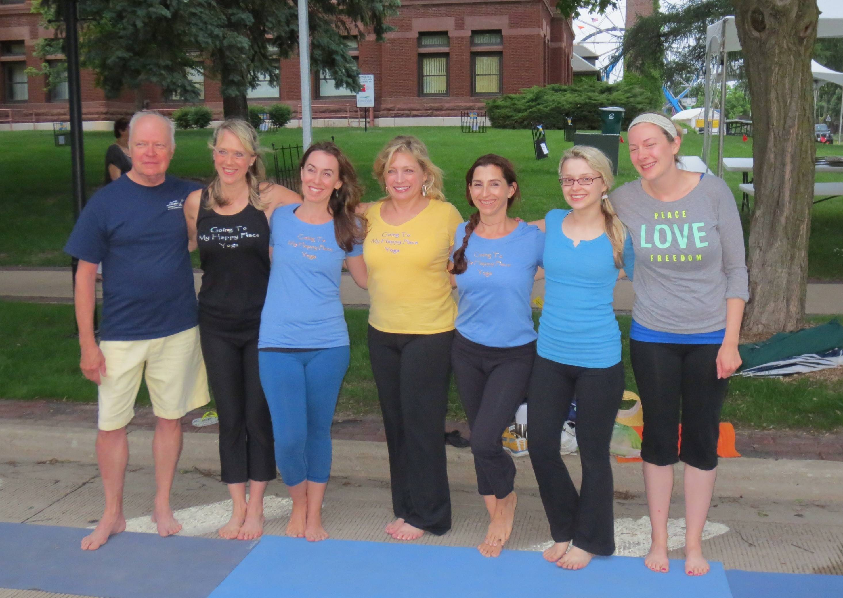 Very happy to officially kick off Swedish Days, some of Going To My Happy Place Yoga's Demo Team smiling are L-R, Richard Keslinke, Debbie Leoni, Rita Esparza, Laurie Milbourn, April Waldrop, Crystal Skipworth and Leah Kamm.