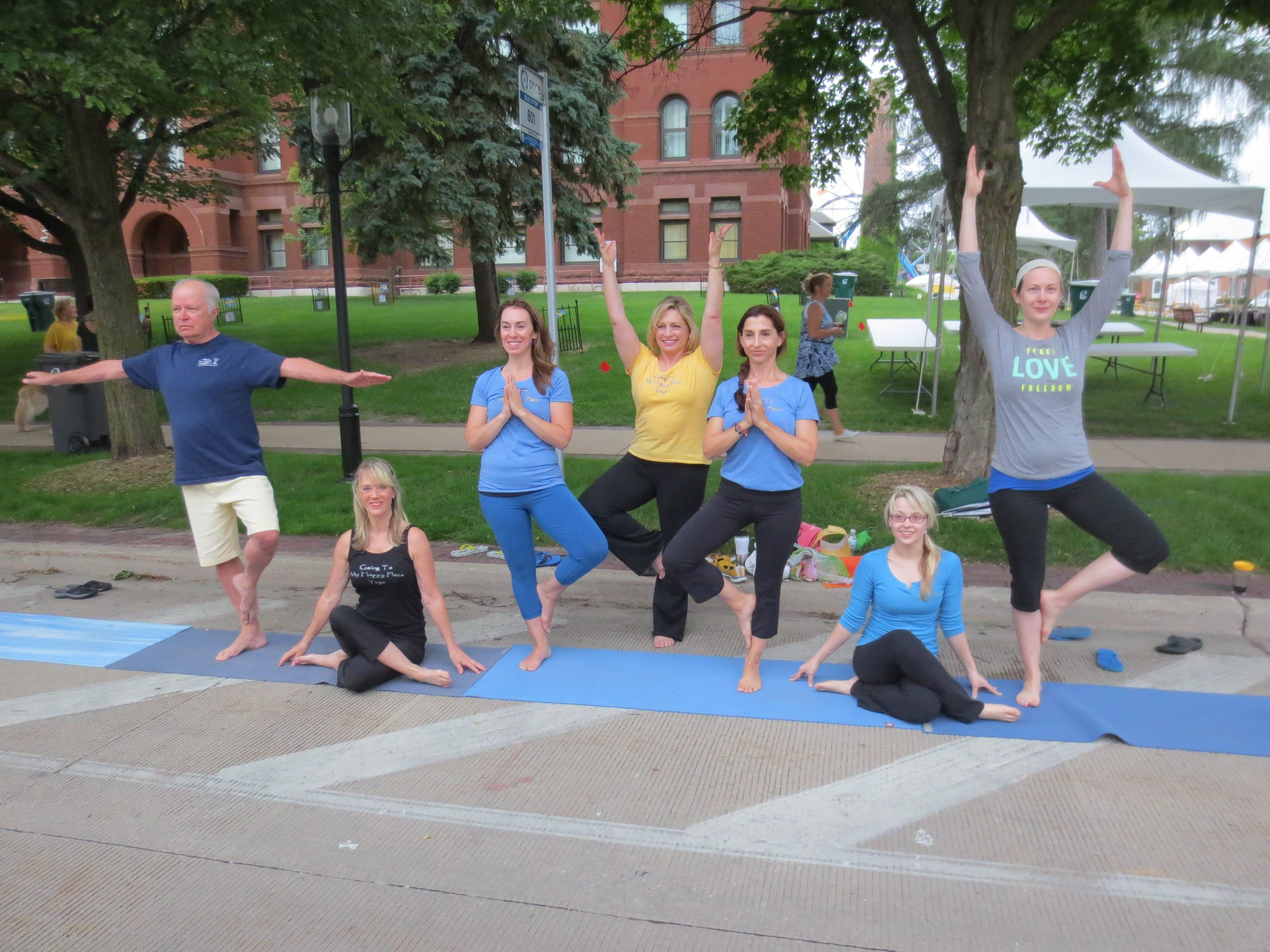 Kicking off Swedish Days brought out the best from Going To My Happy Place Yoga's instructors and students. Shown here in various yoga poses are Richard Keslinke, left, Debbie Leoni, Rita Esparza, Laurie Milbourn, April Waldrop, Crystal Skipworth and Leah Kamm.
