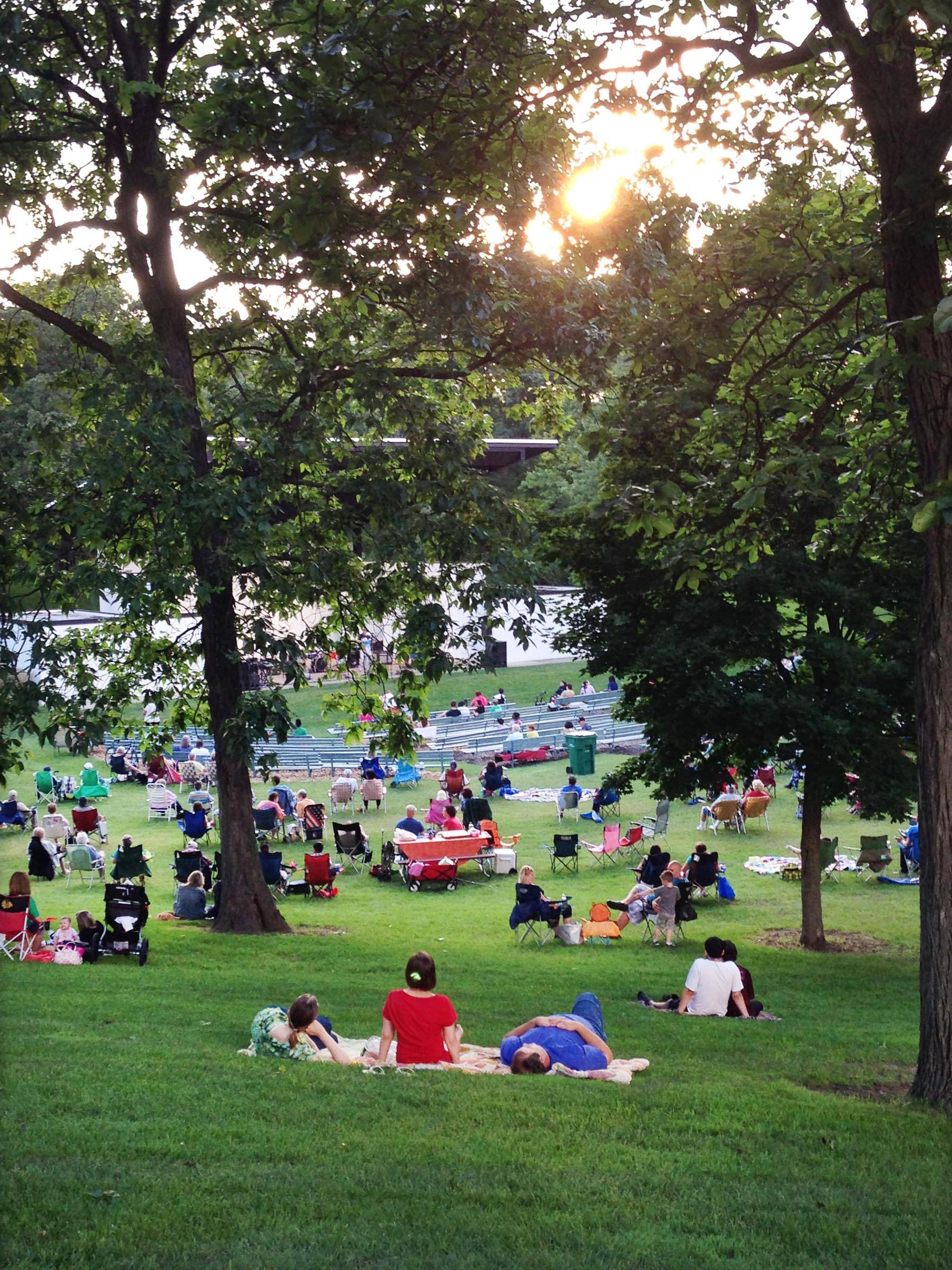 Several hundred people spread out on the grass at Wing Park Tuesday night for a concert by the R Gang band. The Chicago-based quintet played hits of the 1970s. The performance was part of the Elgin Concerts in the Park program.