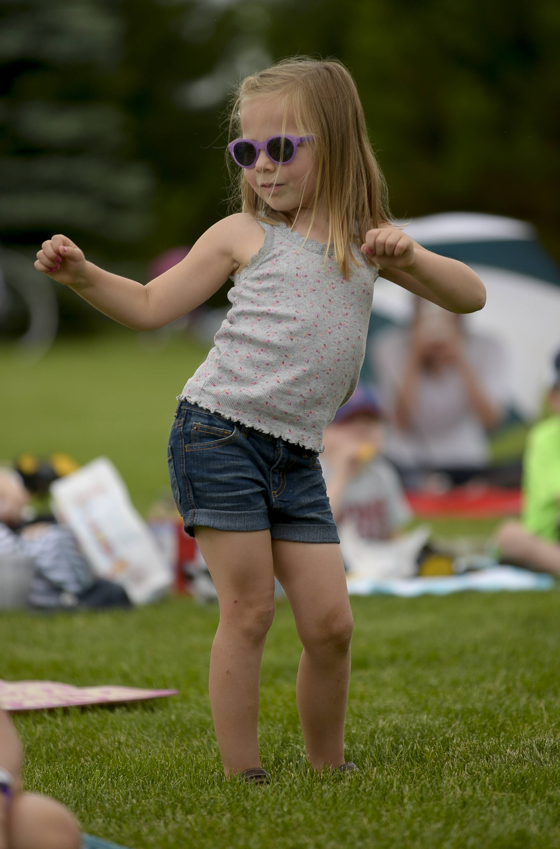 Gianna Brown, 4, of Naperville, dances to the music of the Ice Cream Vendors as they perform Tuesday as part of Naperville Park District's Children's Lunch Hour Entertainment series at Frontier Park.