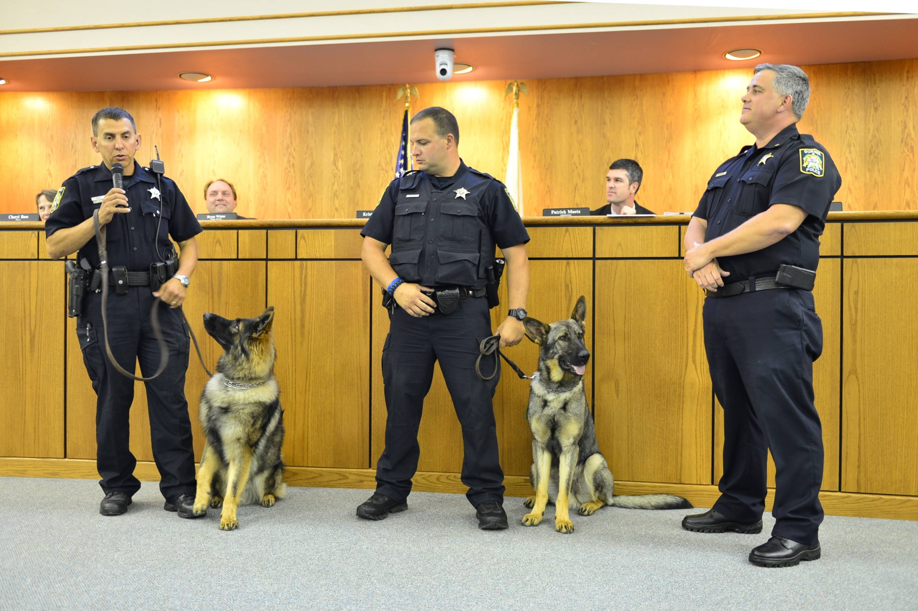 Gurnee police now have two canine units instead of one. Introduced at a recent village board meeting were Officer Philip Mazur and Hunter, left, and Officer J.R. Nauseda with Bear, right. Police Chief Kevin Woodside, right, said the German shepherds rotate shifts, allowing for more daily coverage.