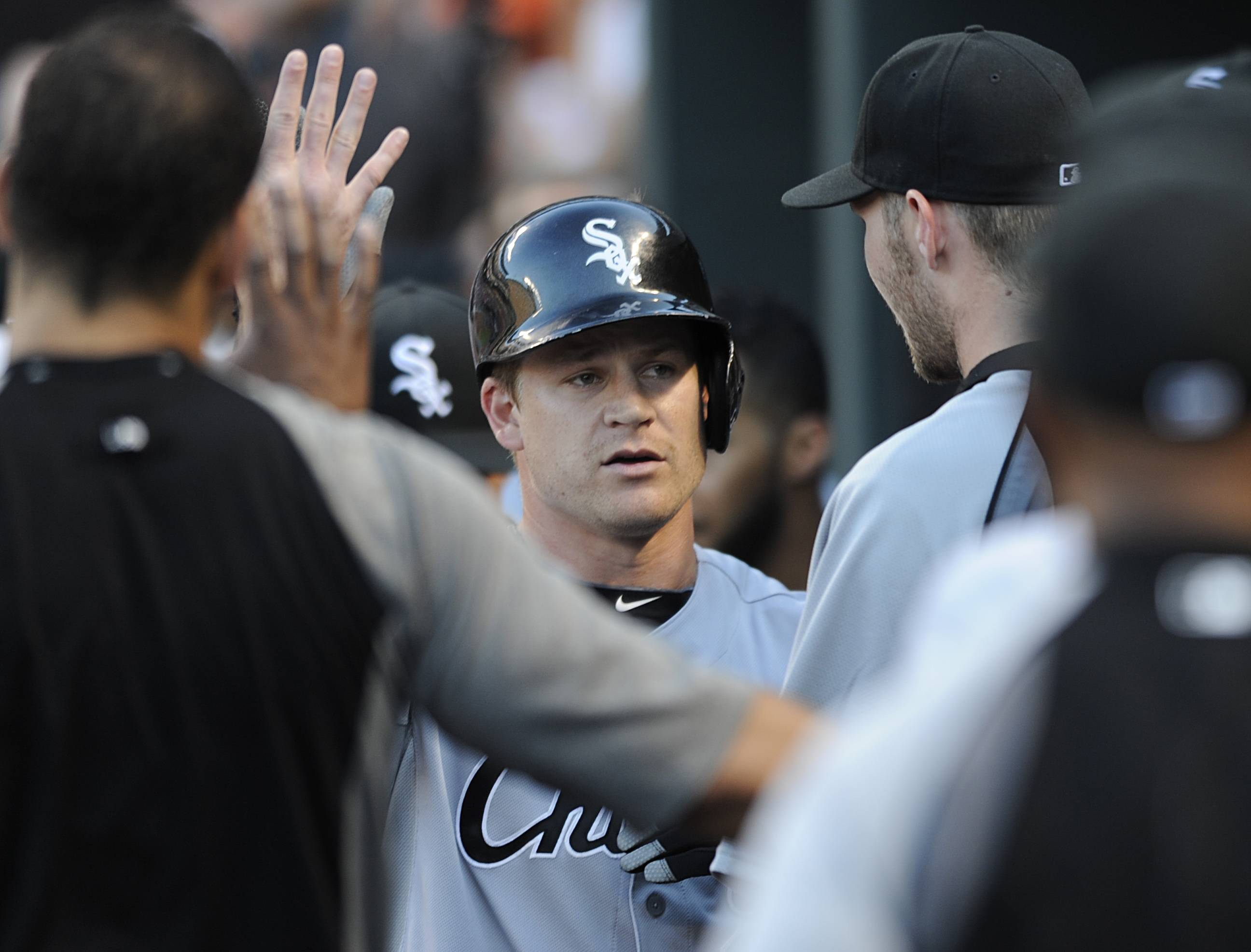 Chicago White Sox second baseman Gordan Beckham, center, is congratulated in the dugout after hitting a solo home run against the Baltimore Orioles in the first inning of a baseball game, Tuesday, June 24, 2014, in Baltimore. (AP Photo/Gail Burton)