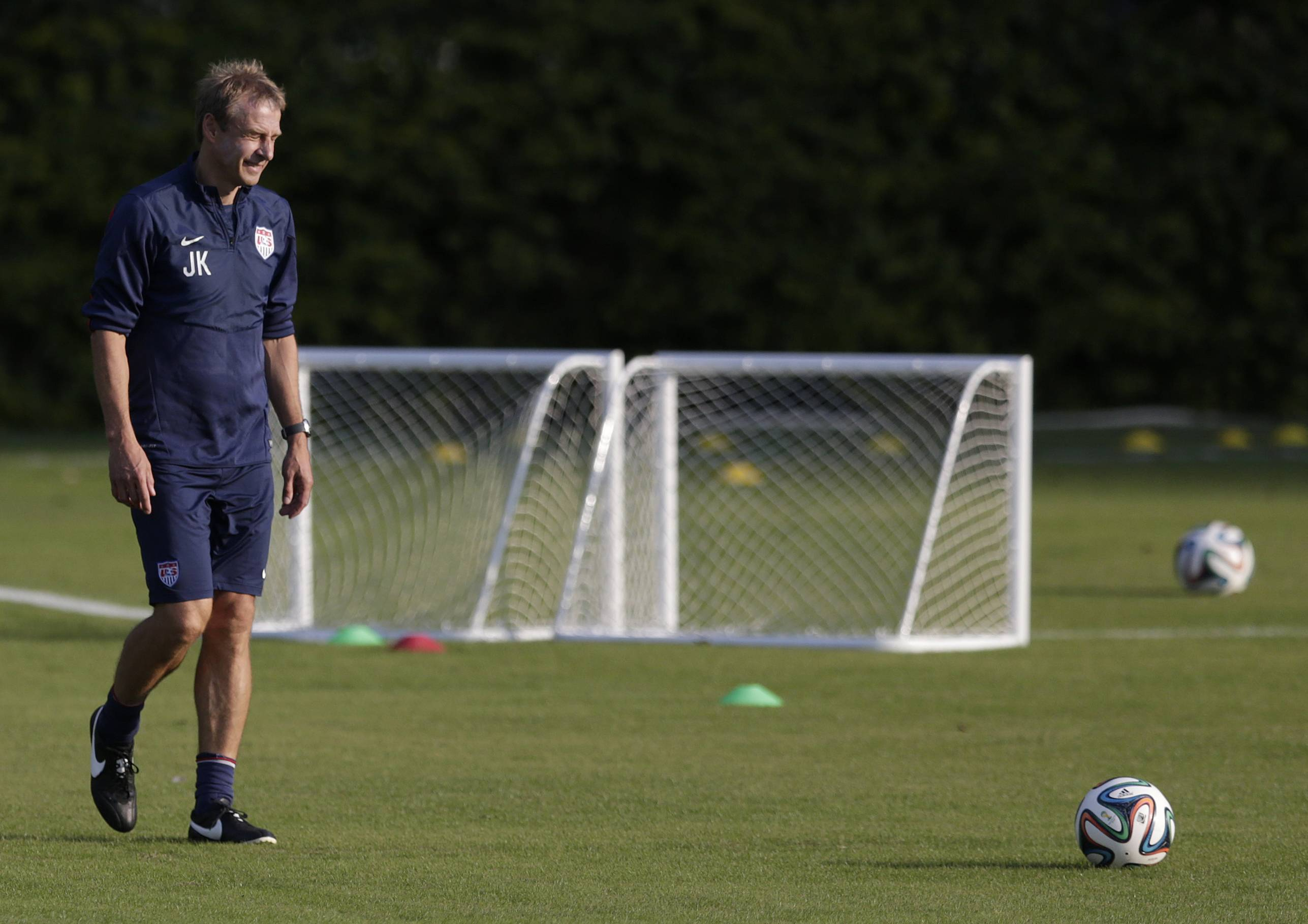 United States' head coach Jurgen Klinsmann walks a practice field during a training session in Sao Paulo, Brazil, Monday, June 23, 2014. The United States will play Germany in group G of the 2014 soccer World Cup on June 26 in Recife, Brazil.
