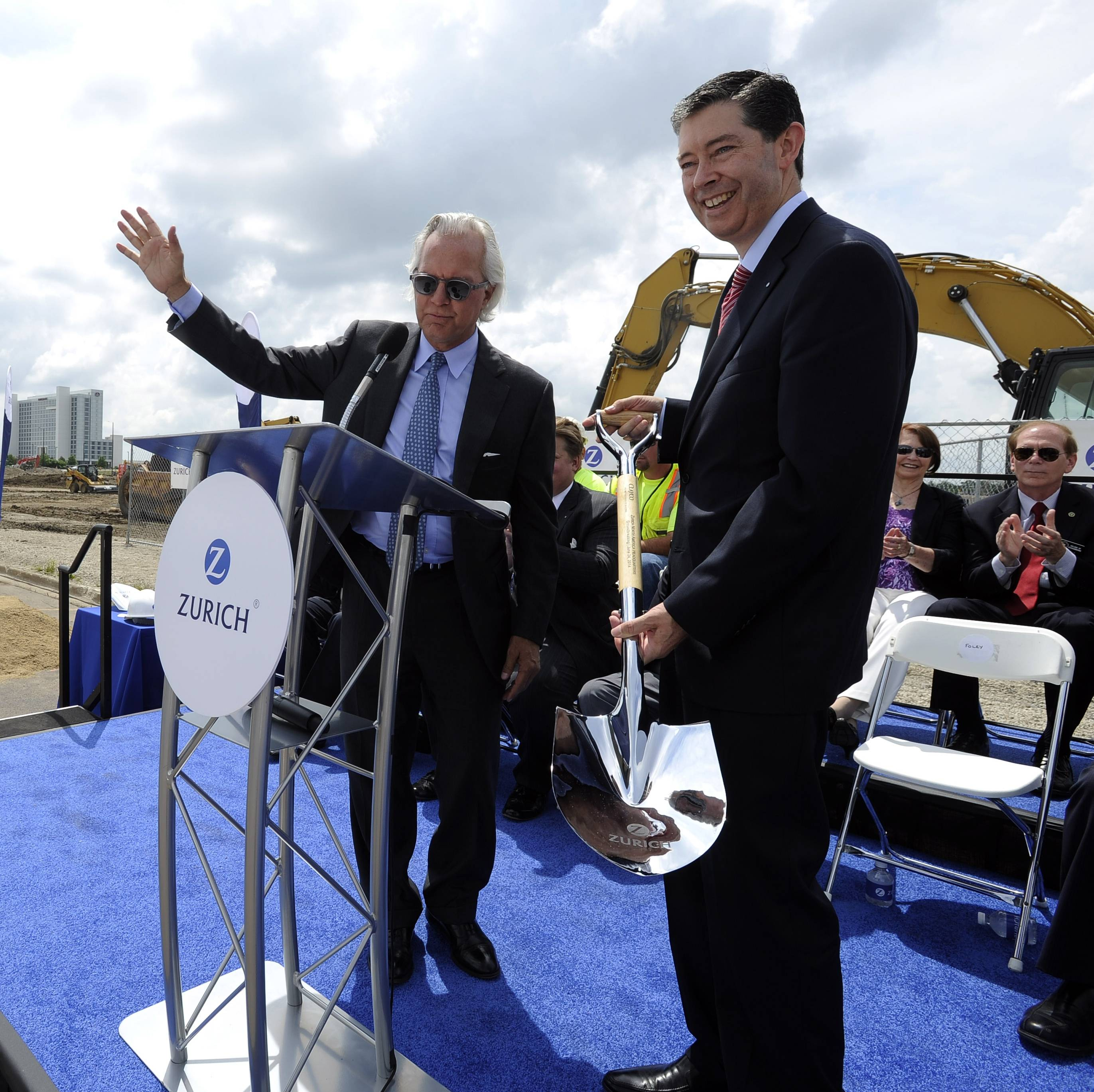 Clayco CEO and Chairman Bob Clark presents Mike Foley, right, CEO of Zurich North America Commercial, with the official groundbreaking shovel as the insurance company begins construction on their new Schaumburg headquarters.