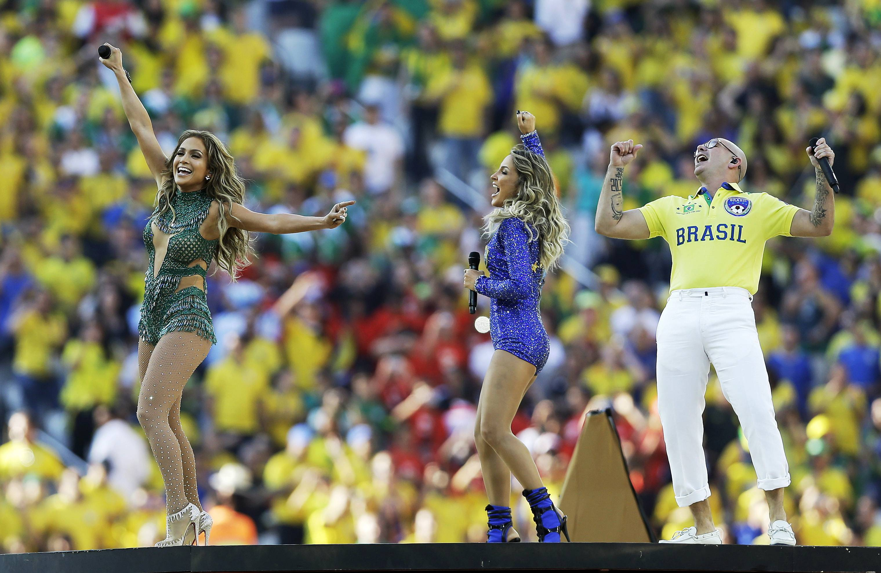 Jennifer Lopez, left, performed with Brazilian singer Claudia Leitte and rapper Pitbull during the World Cup opening ceremony.