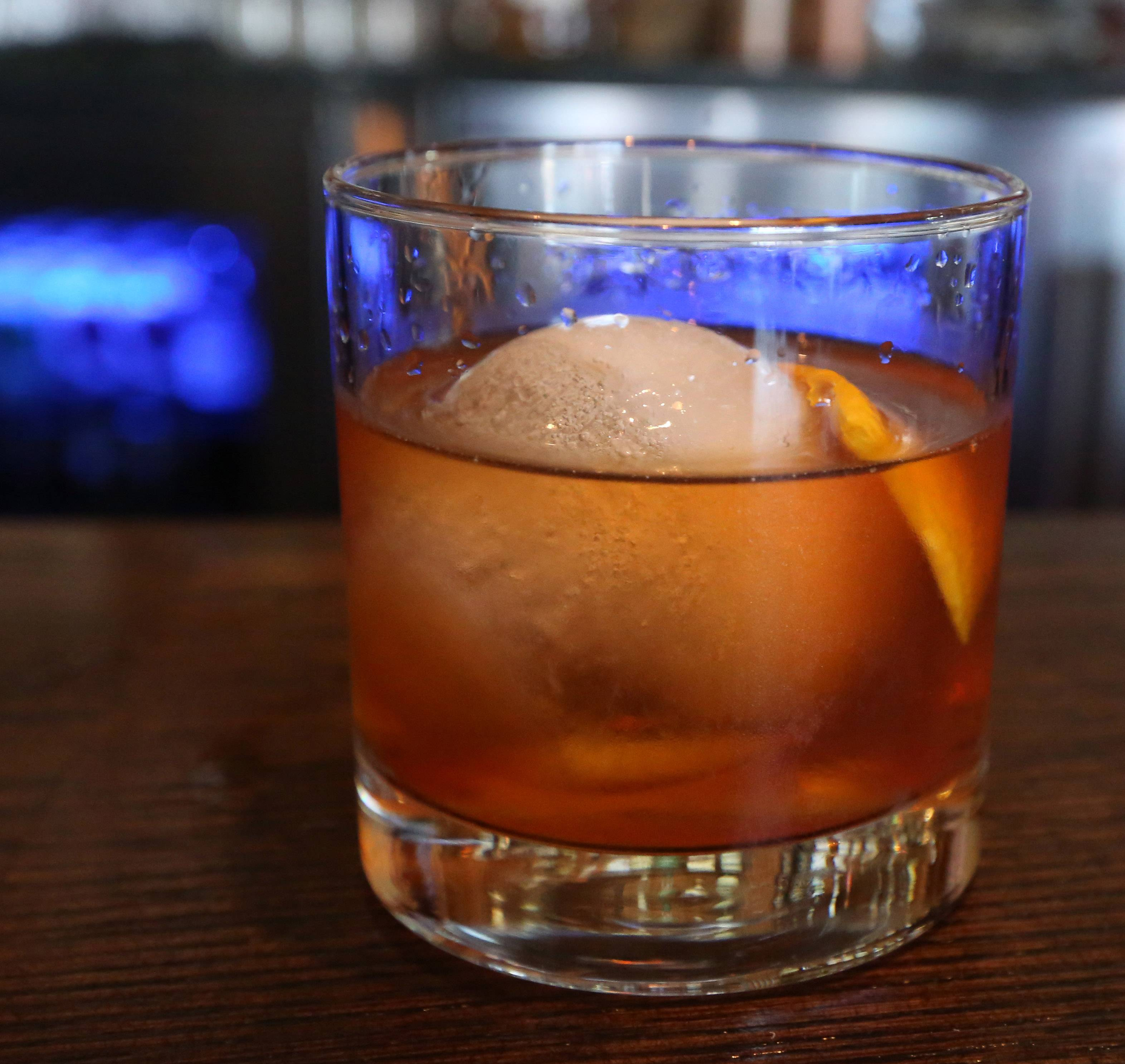 A homemade ball of ice chills an Old Fashion at Spears in Wheeling.