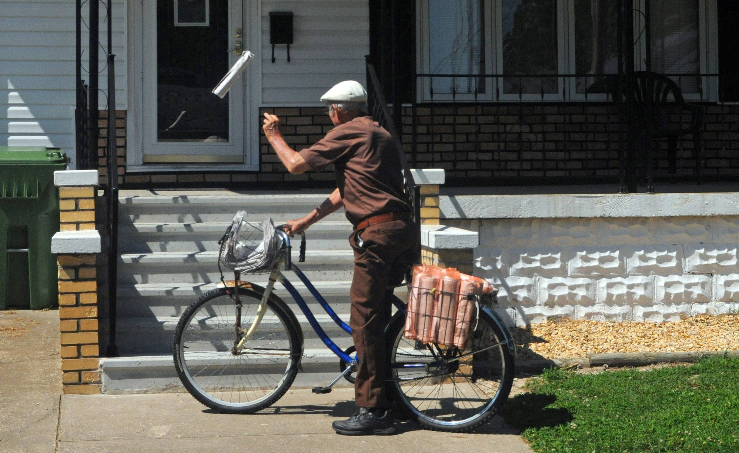 Marvin Teel delivers the Benton Evening News during his paper route in downstate Christopher.
