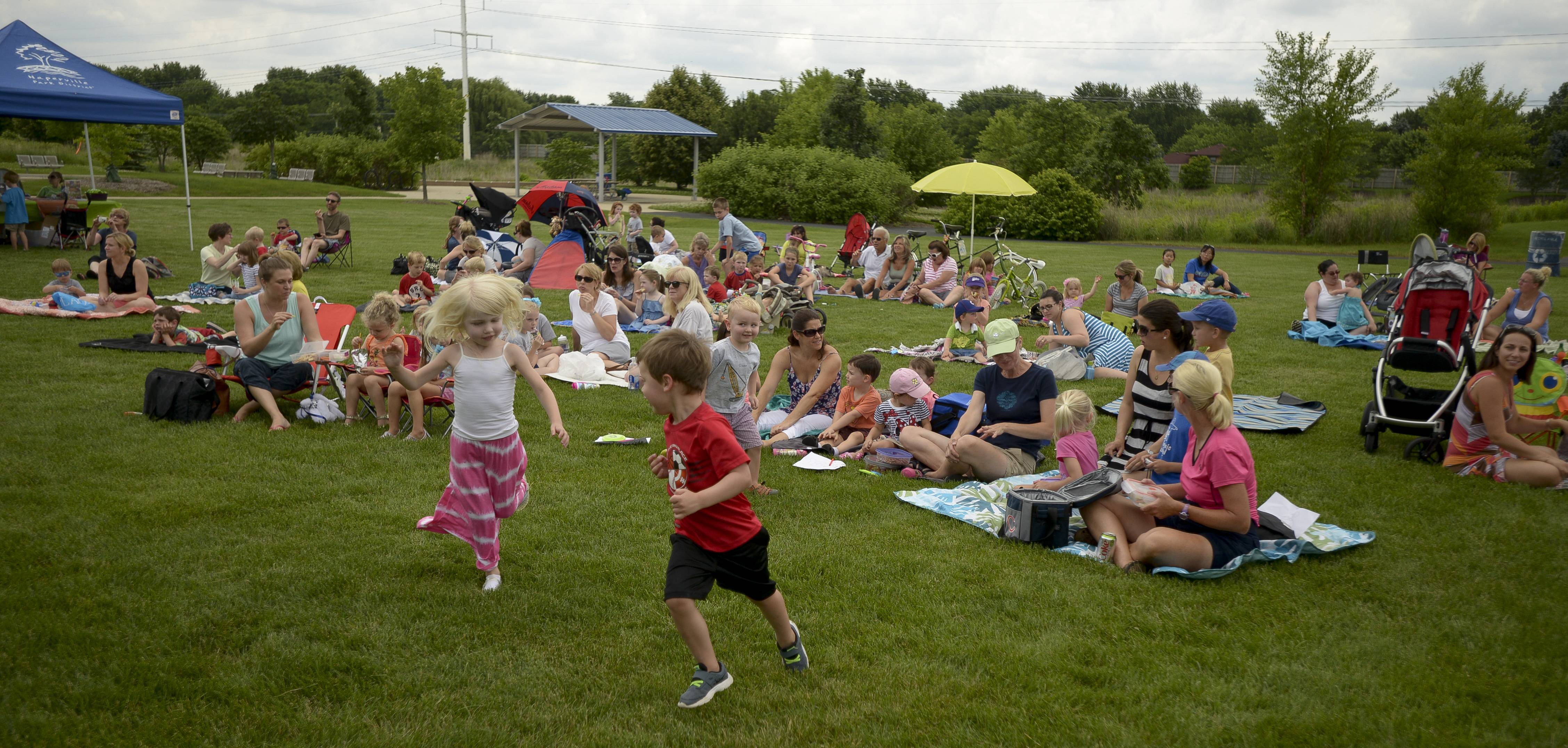 Fans could dance, sing or just eat lunch while watching the Ice Cream Vendors perform Tuesday at Naperville's Frontier Park.