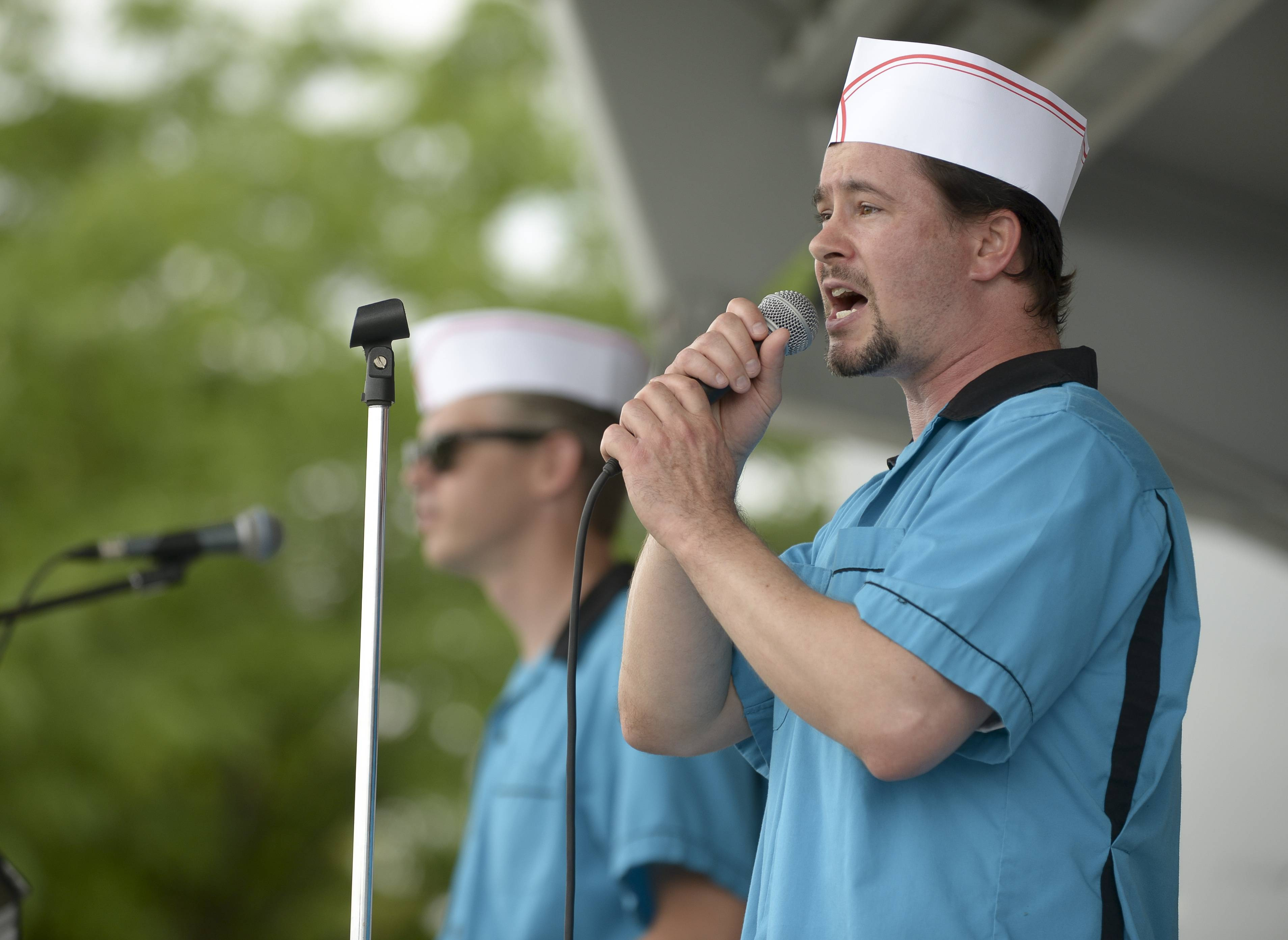 Jon Kostal and Greg Barnett, right, of the Ice Cream Vendors perform as part of Naperville Park District's Children's Lunch Hour Entertainment series.