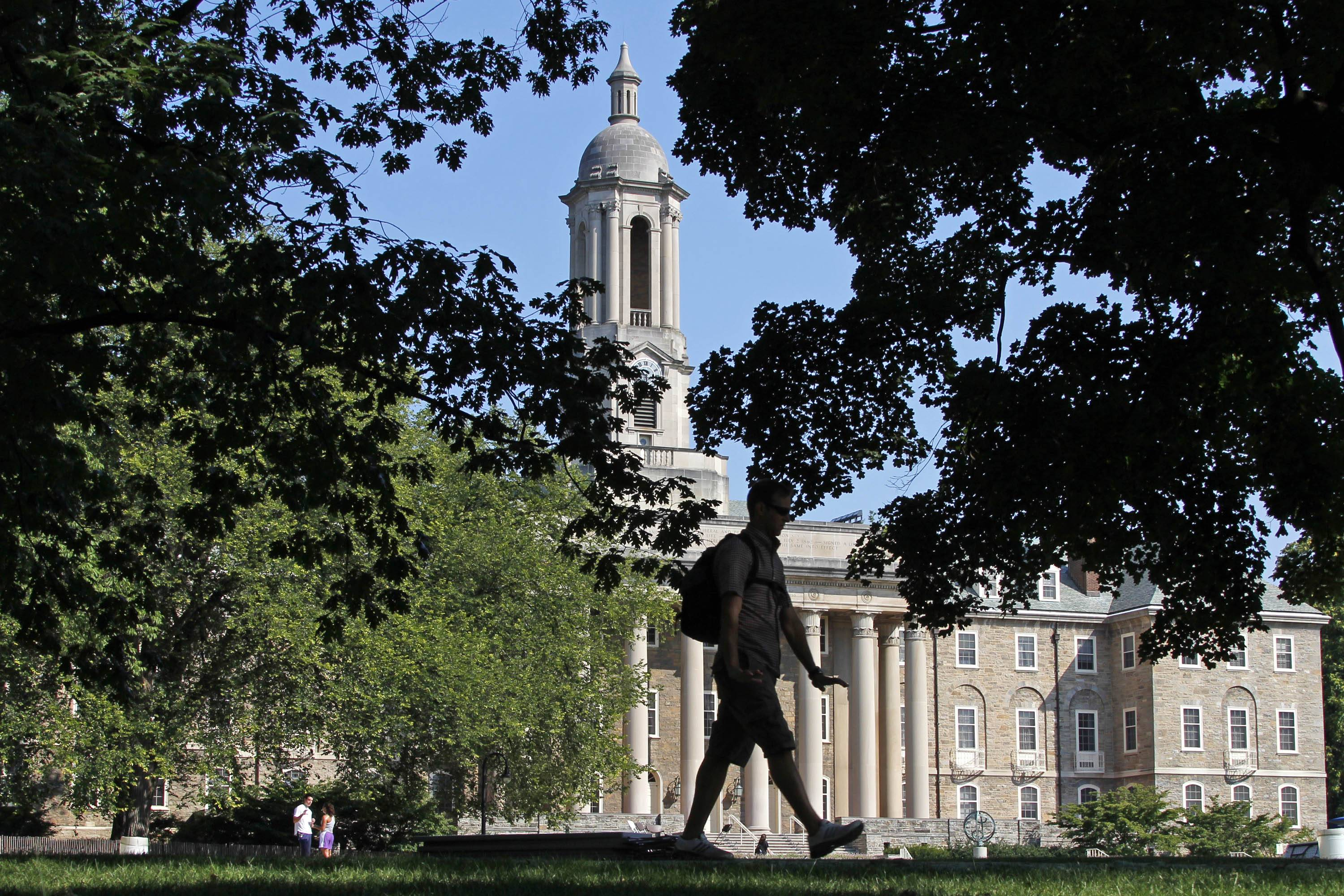 A report released by The Federal Reserve Bank of New York on Tuesday found that a degree is still a good investment for college grads, including those whose jobs don't require college. Seen here, a student walks past Old Main on the campus of Penn State University in State College, Pa.