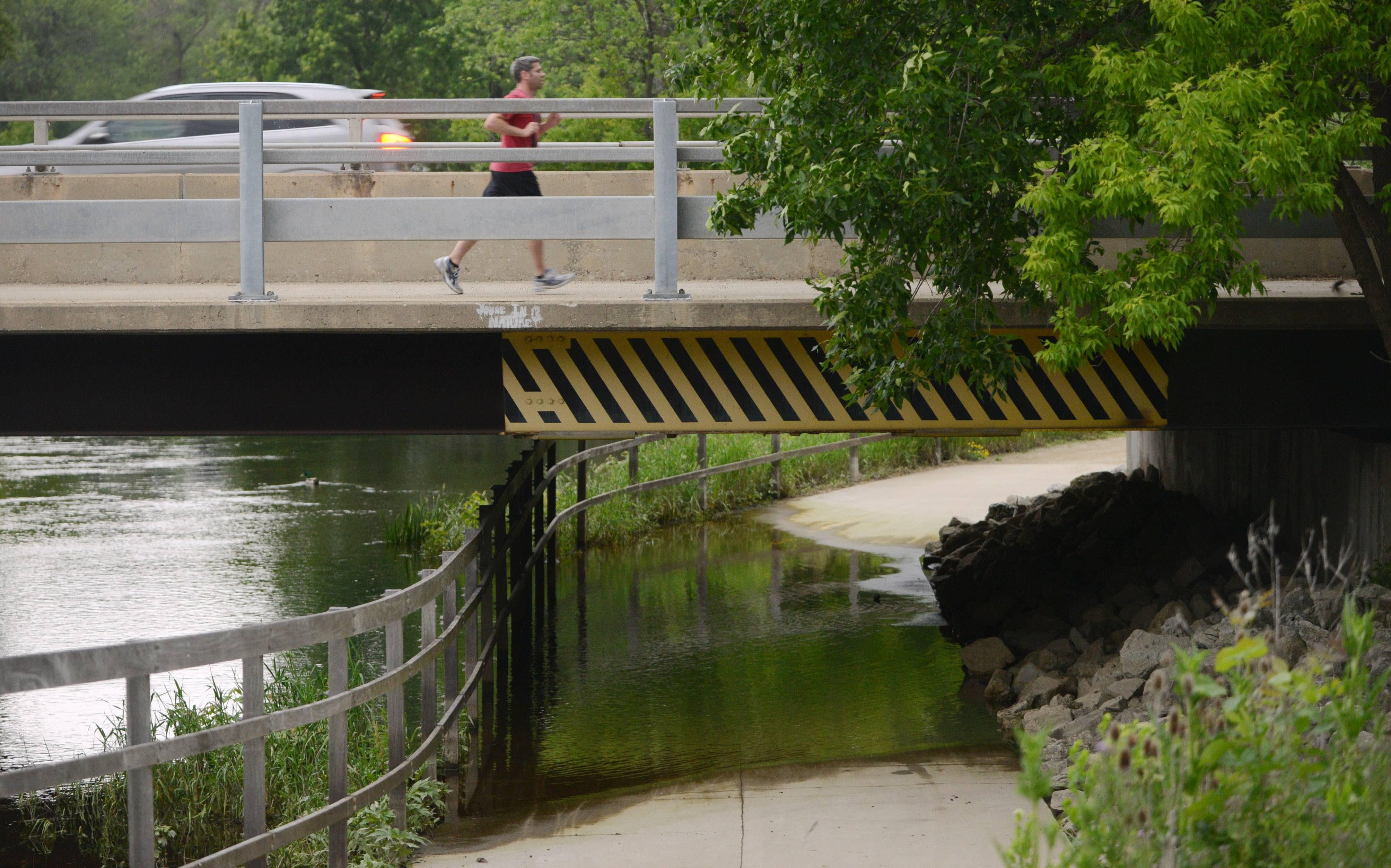A runner heads down the North Shore Bike Path over the Des Plaines River Trail along Route 176 last week. A suspect has been arrested and charged in an assault.