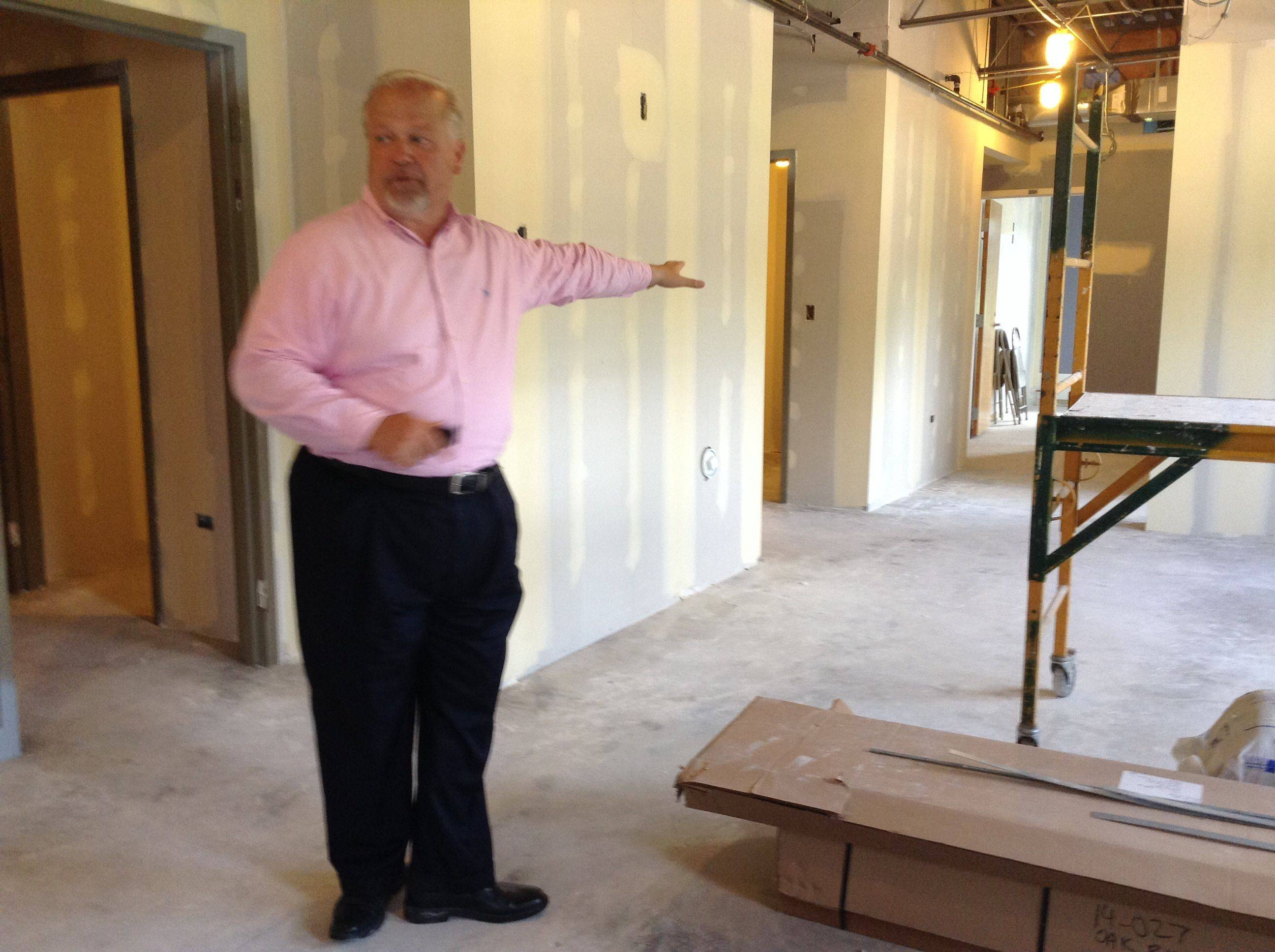 Chuck Bumbales, assistant superintendent of operations for Community Unit District 300, leads a tour through the district's old Carpentersville administration building, which is being converted into a school for Oak Ridge School. For 17 years, the alternative school was housed nearby in about a dozen trailers.