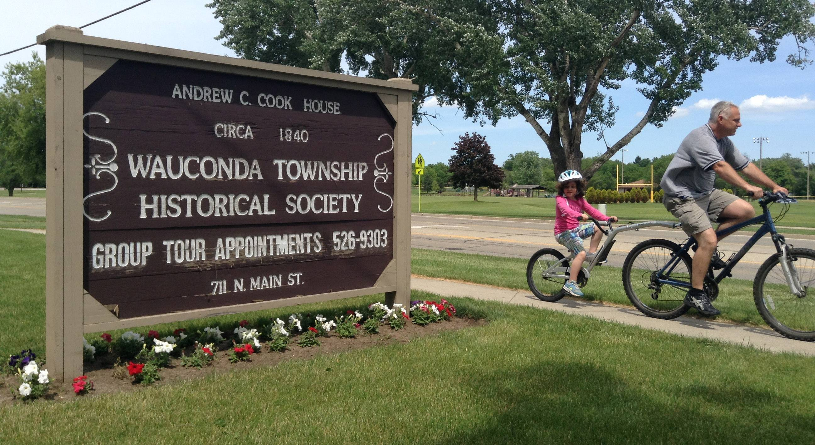 Bicyclists zip past the Wauconda Township Historical Society, which is experiencing a revival.