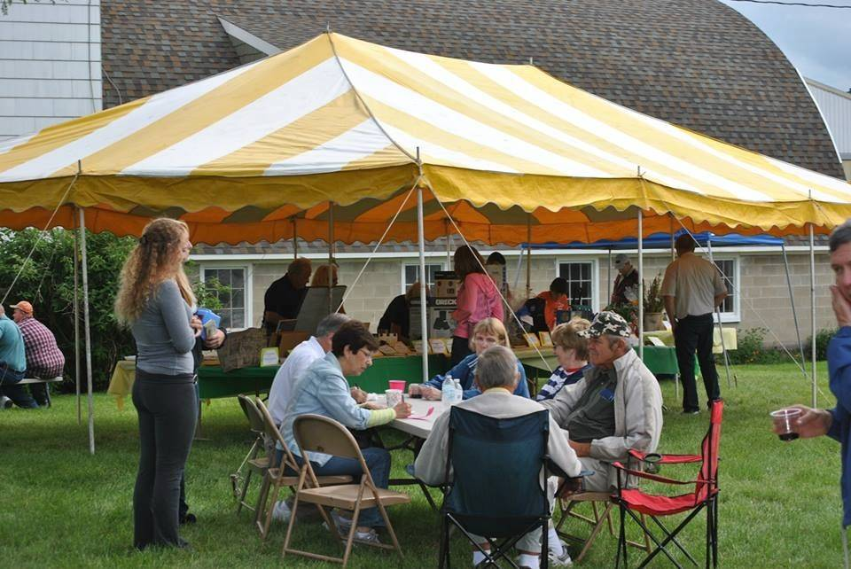 Visitors to the Corron Farm Preservation Society's pig roast can have a meal and tour the grounds.
