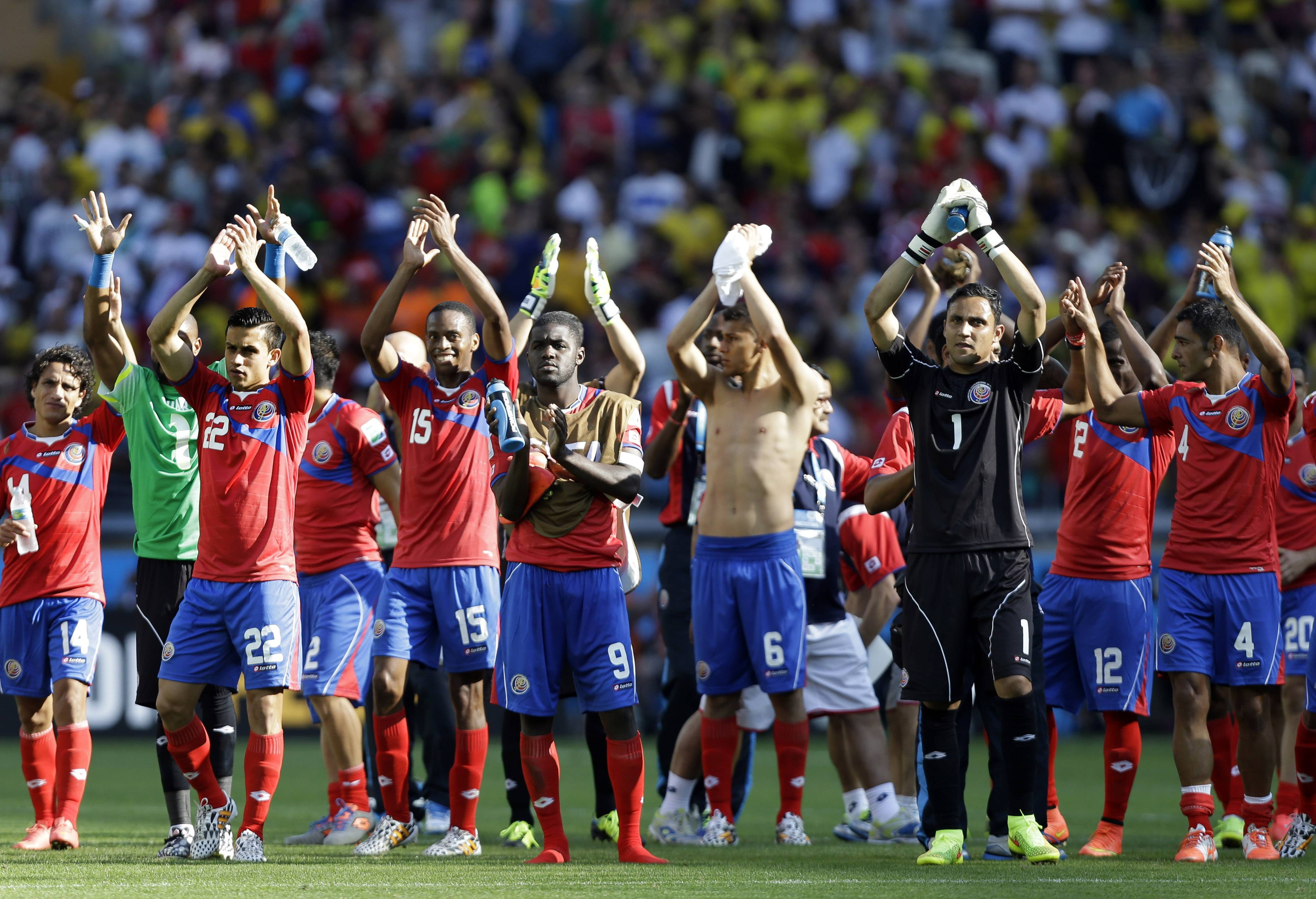 Costa Rica players greet supporters Tuesday after the Group D World Cup match against England at the Mineirao Stadium in Belo Horizonte, Brazil. Costa Rica has finished first in what many considered the World Cup's toughest group after a 0-0 draw against a second-string England side.
