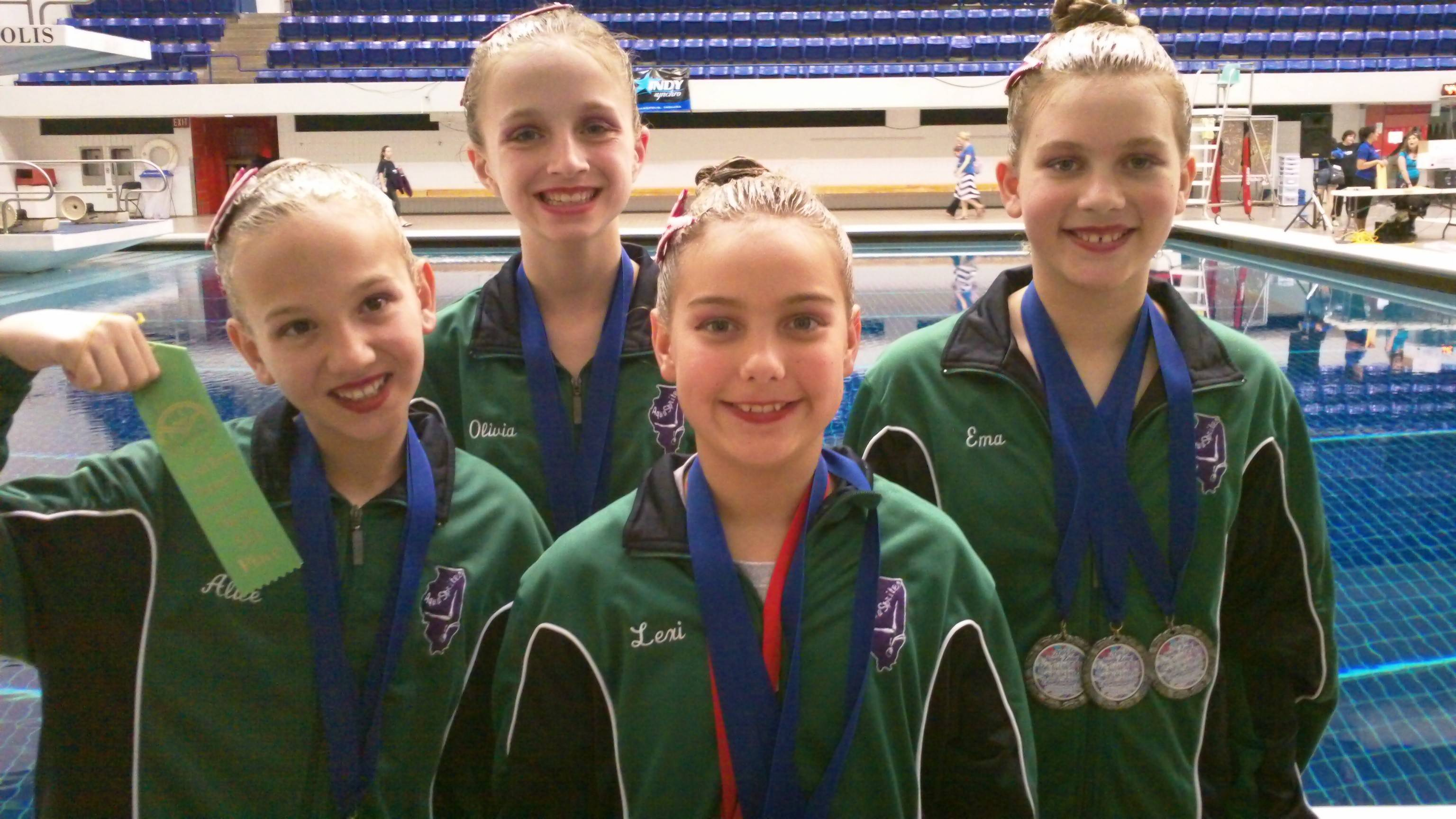 The AquaSprites 11-12 Team shows off their medals after receiving them at the regional championship in Indianapolis. Pictured, from left, are Alice Duska, Olivia Herman, Alexandra Dorula and Ema Glavanovic.