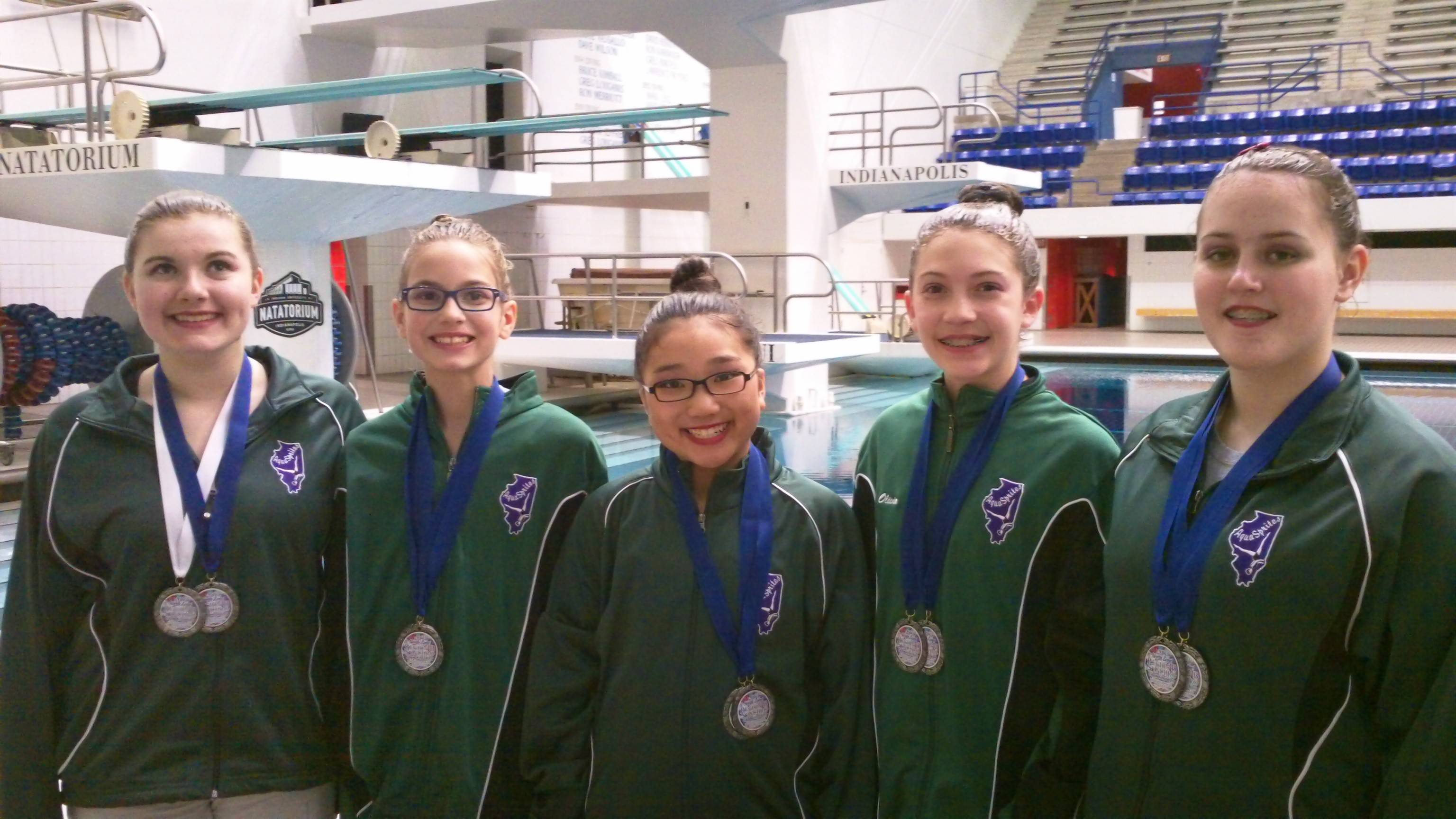 The AquaSprites 13-15 Team, from left, Clemence Rodney, Rebecca Garcia Stam, Chaewon Park, and Olivia Vasilakopoulos with their regional championship medals.