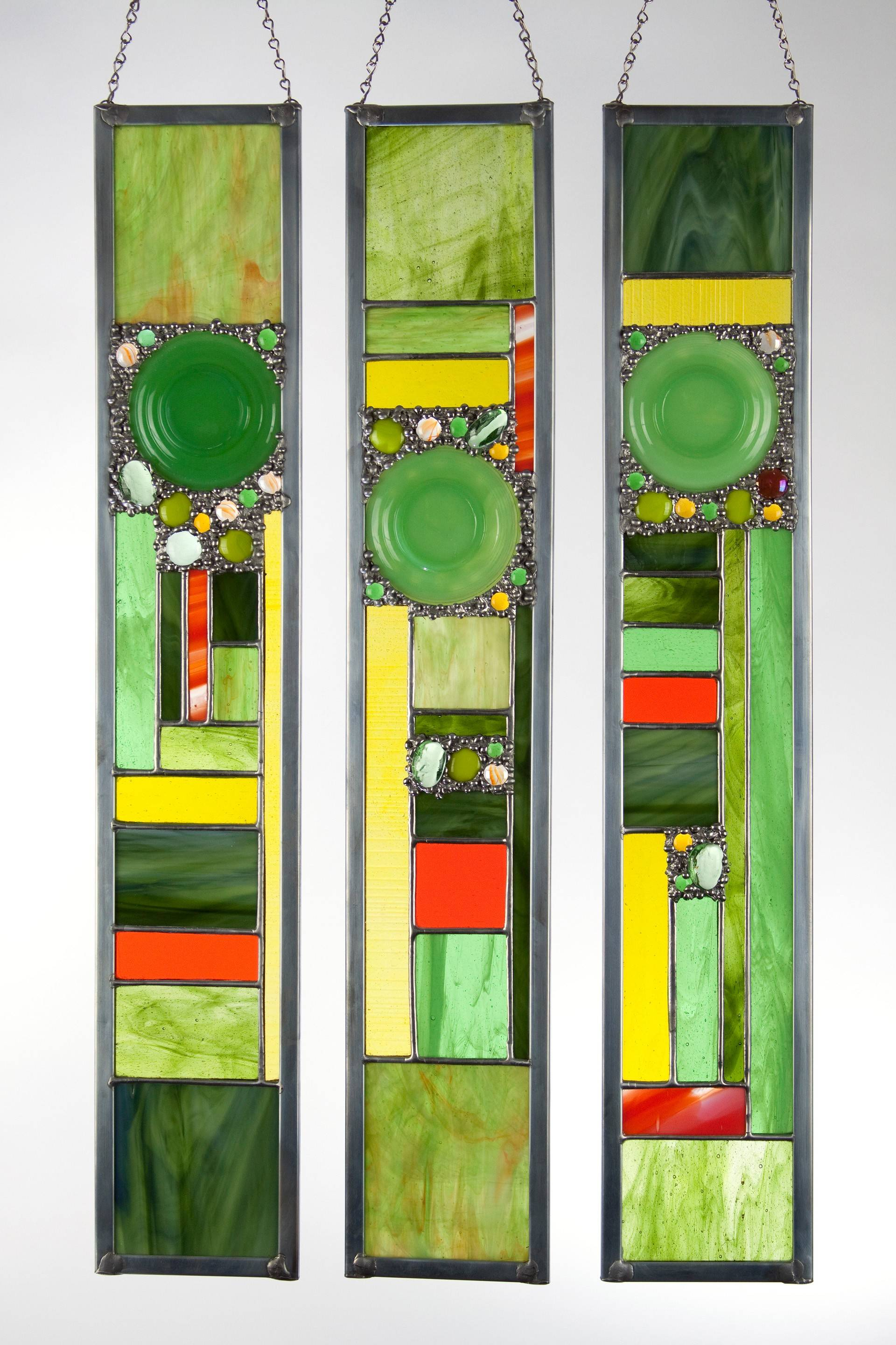 """My artwork is a unique blending of antique Depression glass dishes and contemporary stained glass. Starting with my focal point, glass is cut and custom fit as the panel evolves. This provides me with a freedom to create as I craft each piece of art glass."" -- Retta Hentschel, Aurora glass artist"