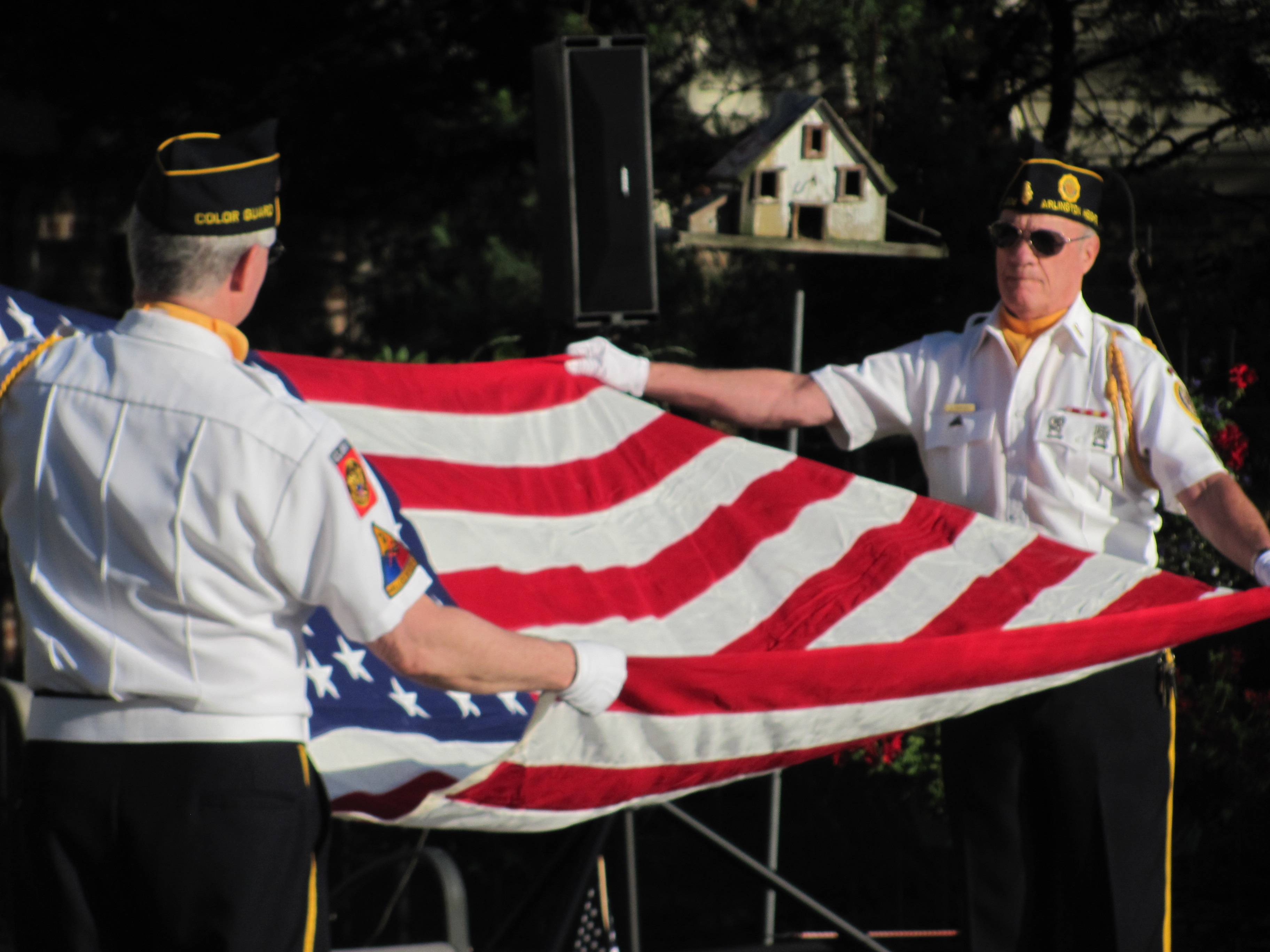 American Legion Merle Guild Post 208 award-winning color guard in Flag folding ceremony at Rotary event in the Glueckert family's backyard.Rob Gollberg