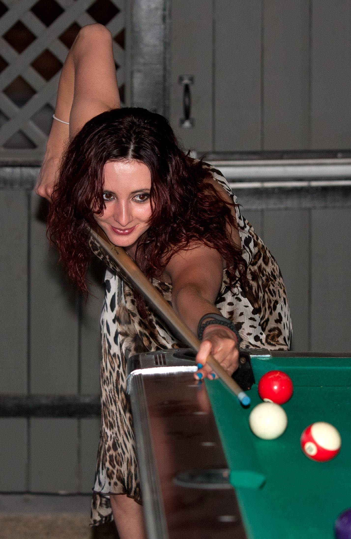 Jelena Lukic of Elk Grove Village enjoys playing pool outdoors at Gnarly J's in Downers Grove.