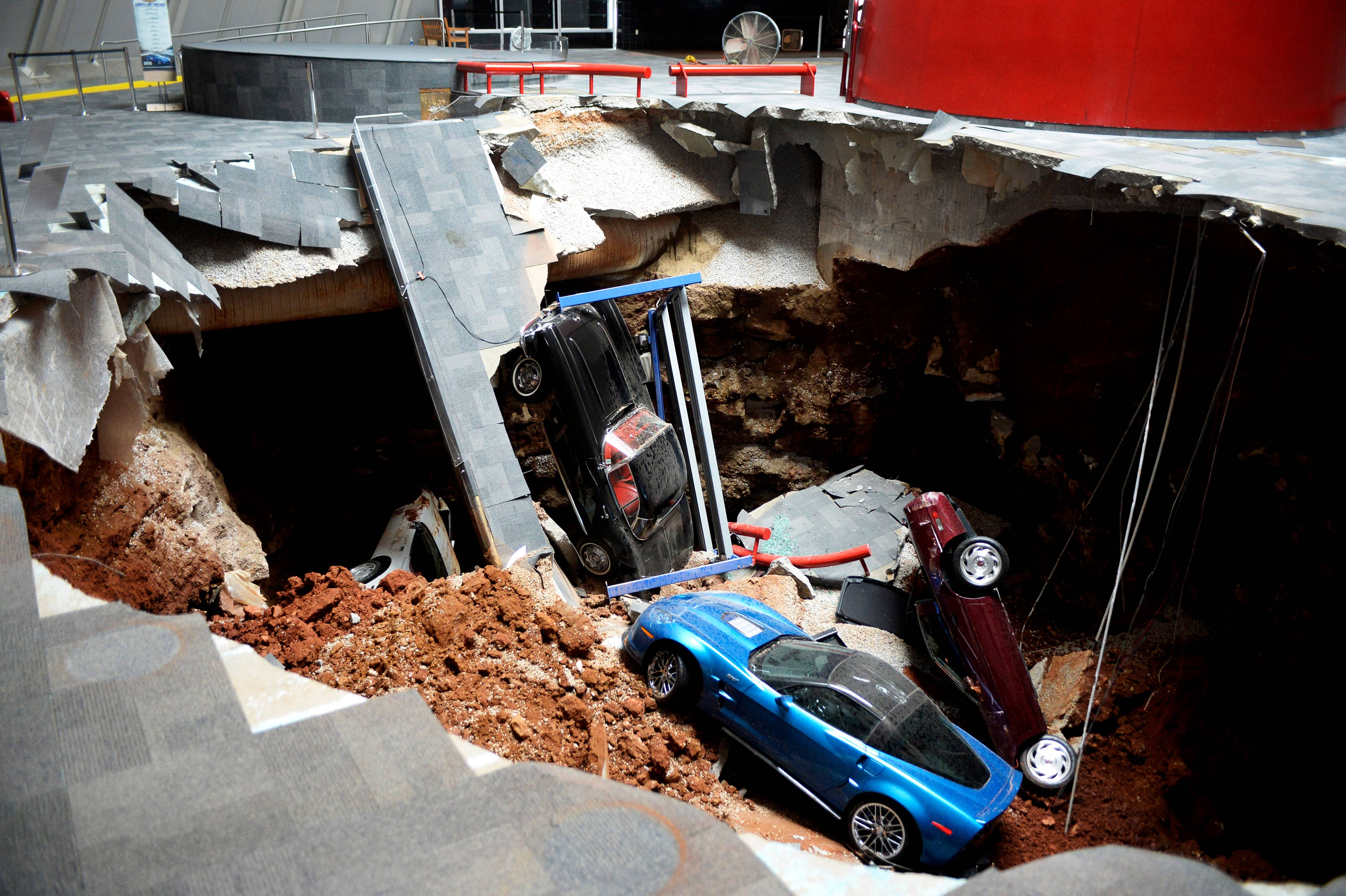 Prized cars lie in a sinkhole that opened up in the National Corvette Museum in Bowling Green, Ky., on Feb. 12. The sinkhole that swallowed eight cars at the has become such an attraction that officials want to preserve it.