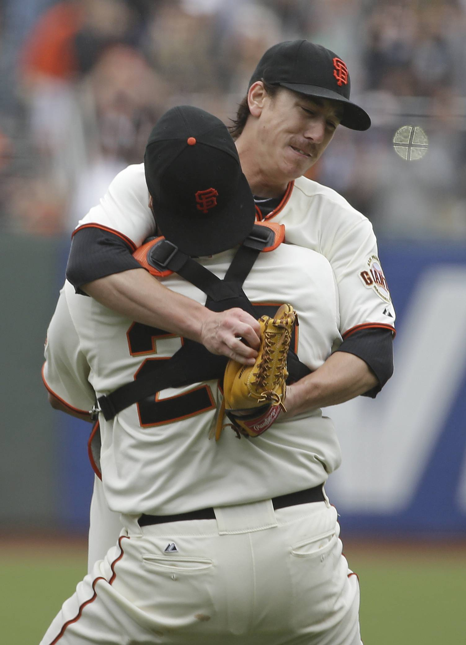 San Francisco Giants pitcher Tim Lincecum is embraced by catcher Hector Sanchez after throwing a no-hitter against the San Diego Padres on Wednesday. Lincecum threw his second career no-hitter. San Francisco won 4-0.