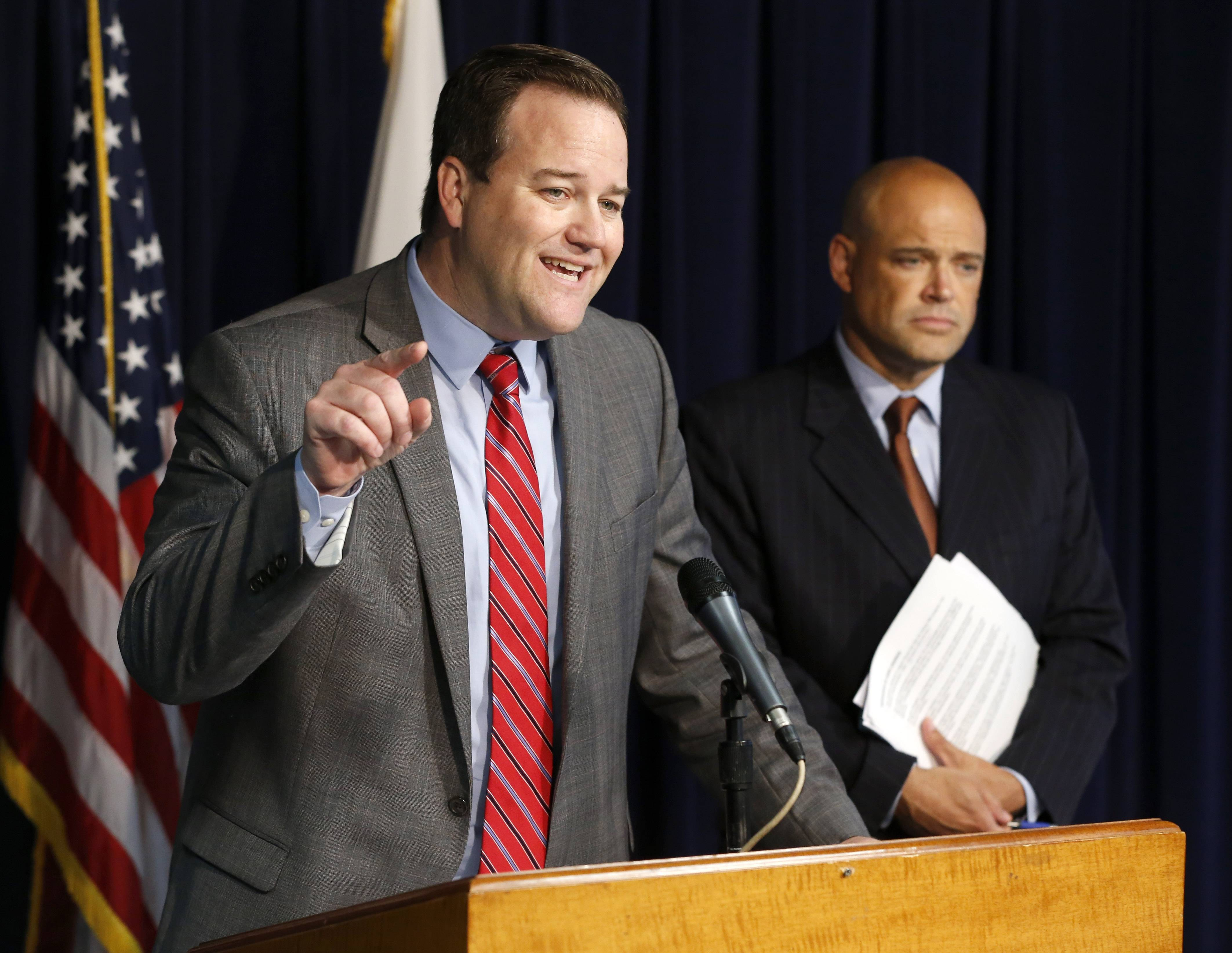 State Sen. Matt Murphy, left, talks about Gov. Pat Quinn's anti violence program as state Rep. Ron Sandack listens during a news conference Wednesday in Chicago.