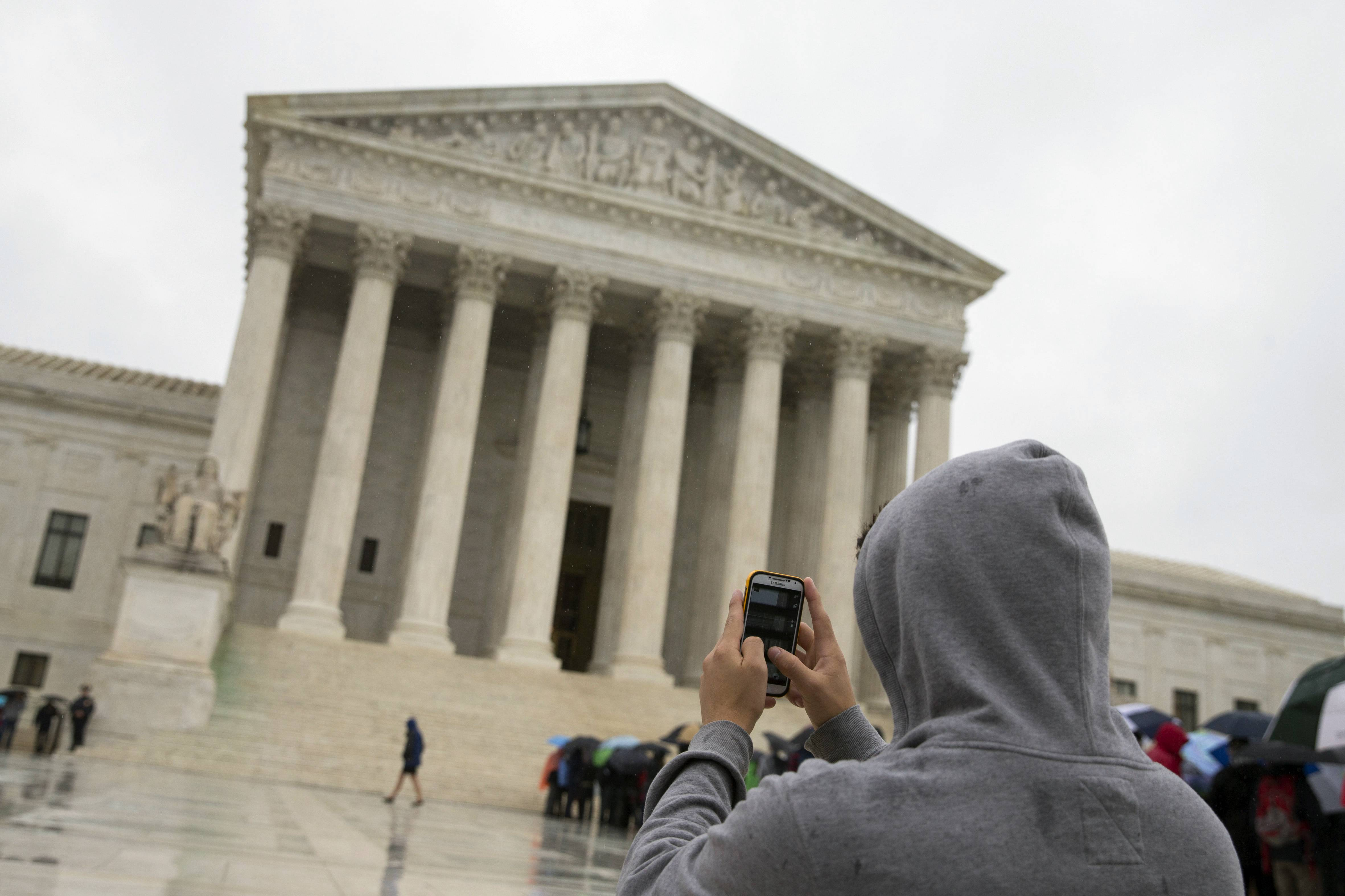 Police may not generally search the cellphones of people they arrest without first getting search warrants, the Supreme Court ruled Wednesday. The court said cellphones are powerful devices unlike anything else police may find on someone they arrest.