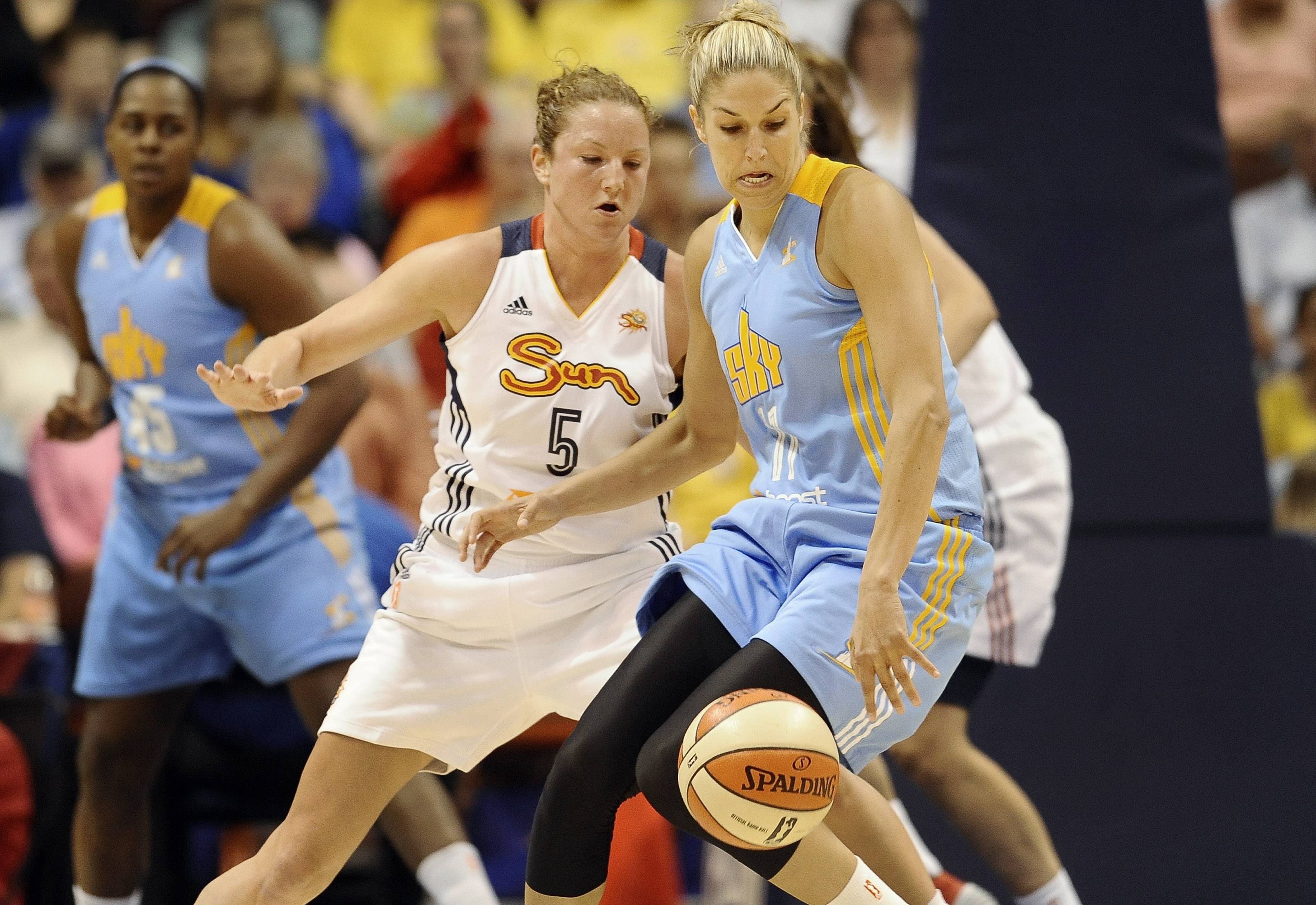 Chicago Sky's Elena Delle Donne, right, keeps the ball ahead of Connecticut Sun's Kelsey Griffin, left, during the first half of a WNBA basketball game, Wednesday, June 25, 2014, in Uncasville, Conn. (AP Photo/Jessica Hill)
