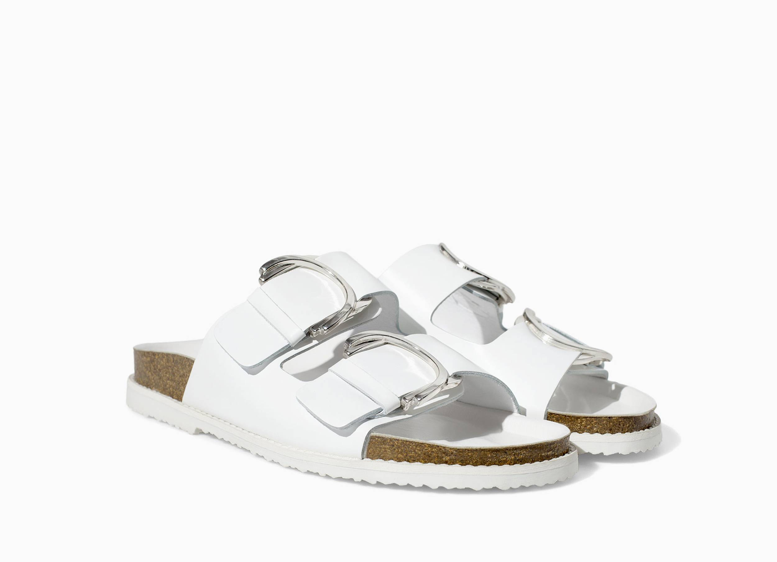 This pair of white sandals with buckles is one of the wardrobe essentials for summer, according to Dana Avidan-Cohn, a senior editor at InStyle magazine.
