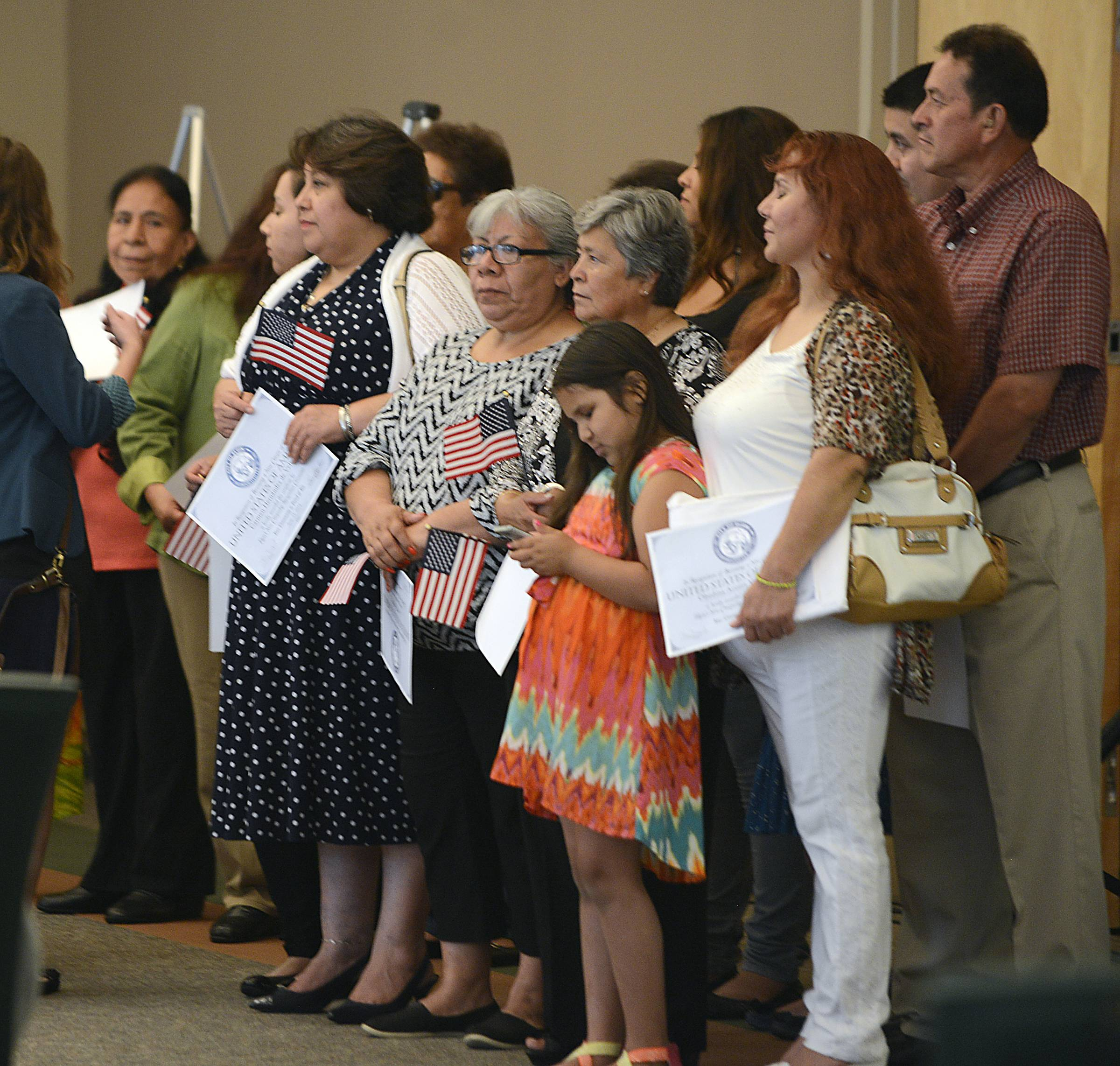 The U.S. citizens honored in Elgin Wednesday night came from countries including Peru, Honduras, Colombia, Guatemala, Macedonia, Laos, the Philippines and Thailand.