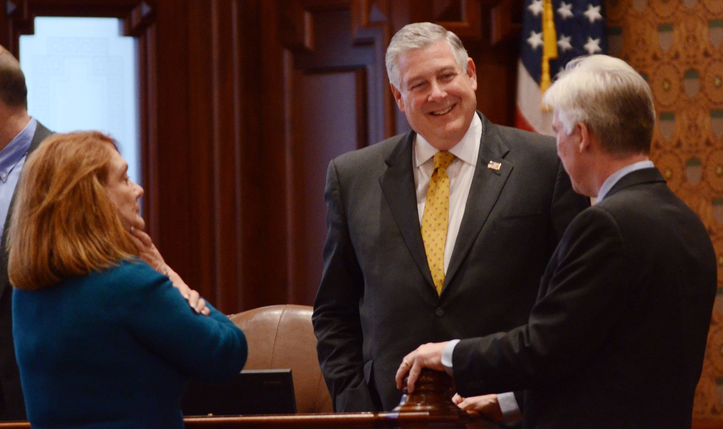 State Sen. Kirk Dillard, a Hinsdale Republican, will leave the Illinois Senate at the end of July. He talks with state Sens. Pam Althoff, a McHenry Republican, and Michael Connelly, a Lisle Republican, on the floor of the Senate Wednesday.