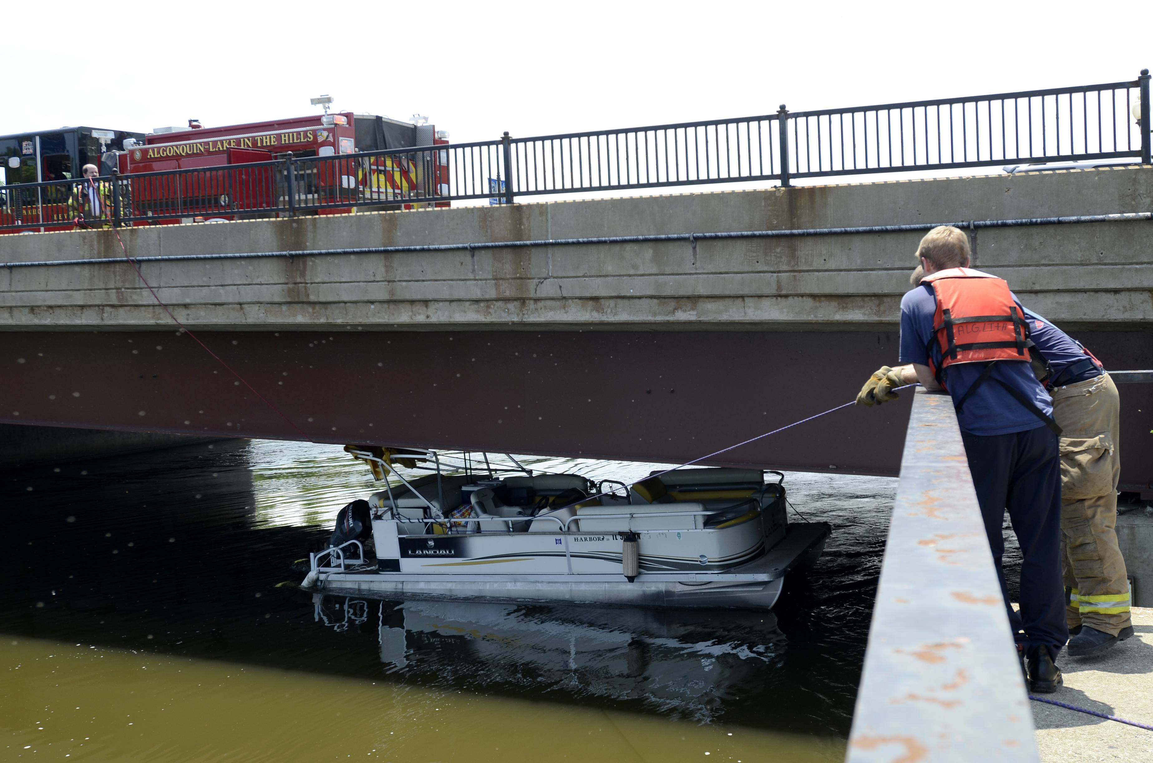 Grace and Steve Leseth were rescued from their pontoon boat Wednesday afternoon under the Algonquin Road bridge by the Algonquin-Lake in the Hills Fire Protection District.