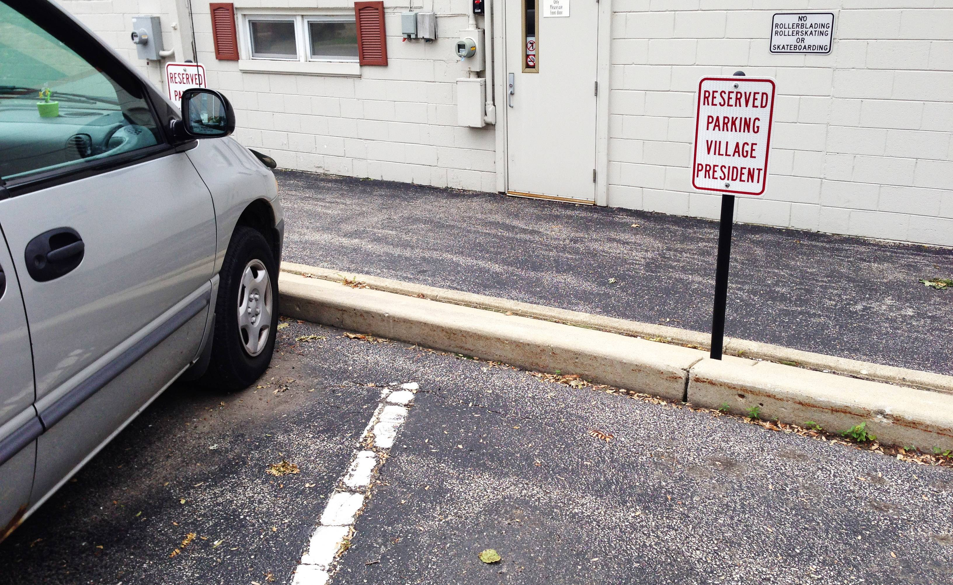 Some Wauconda village officials have reserved parking spaces behind the village hall.