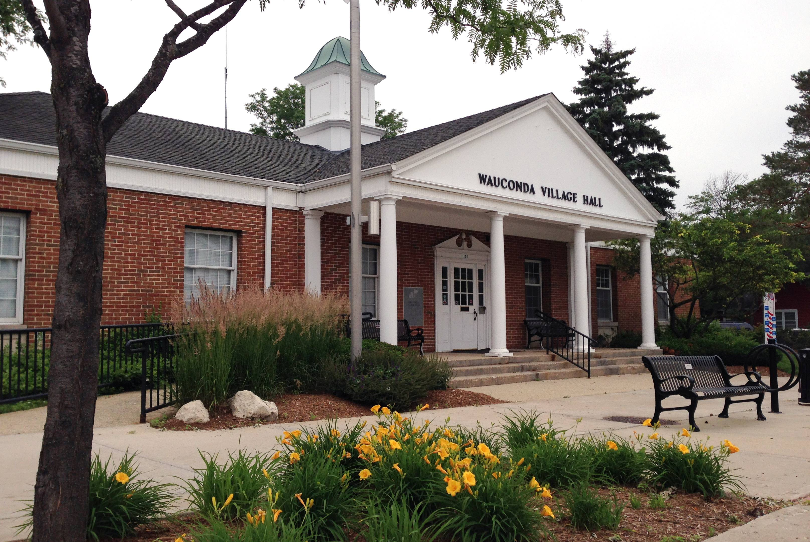 Officials are considering restricting parking at village hall on meeting nights.