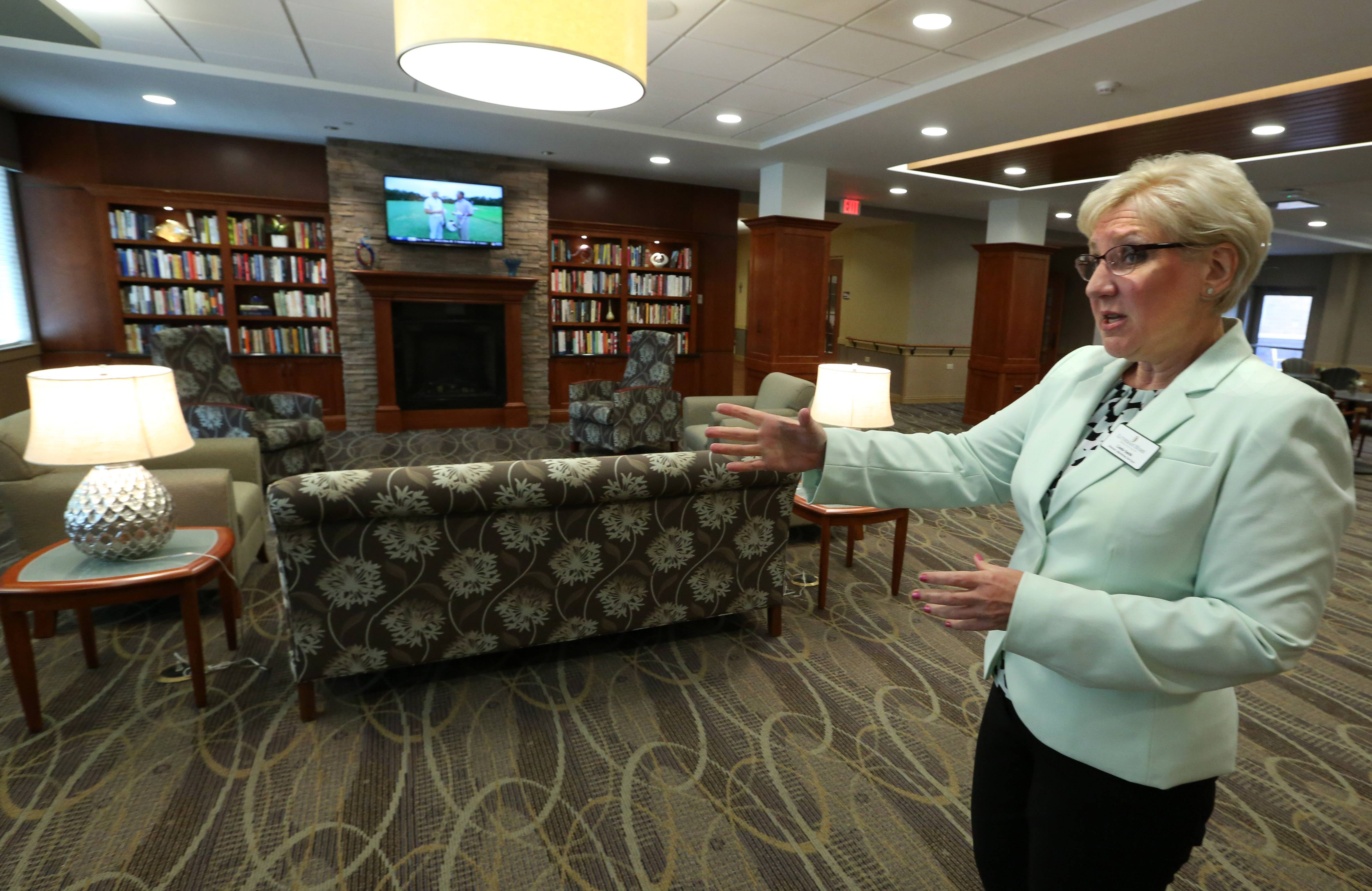 Linda Smith, director of marketing services for Lutheran Home, shows the lounge off the bistro dining area at Lutheran Home's new MyRehab Center in Arlington Heights. The new facility opens Wednesday.