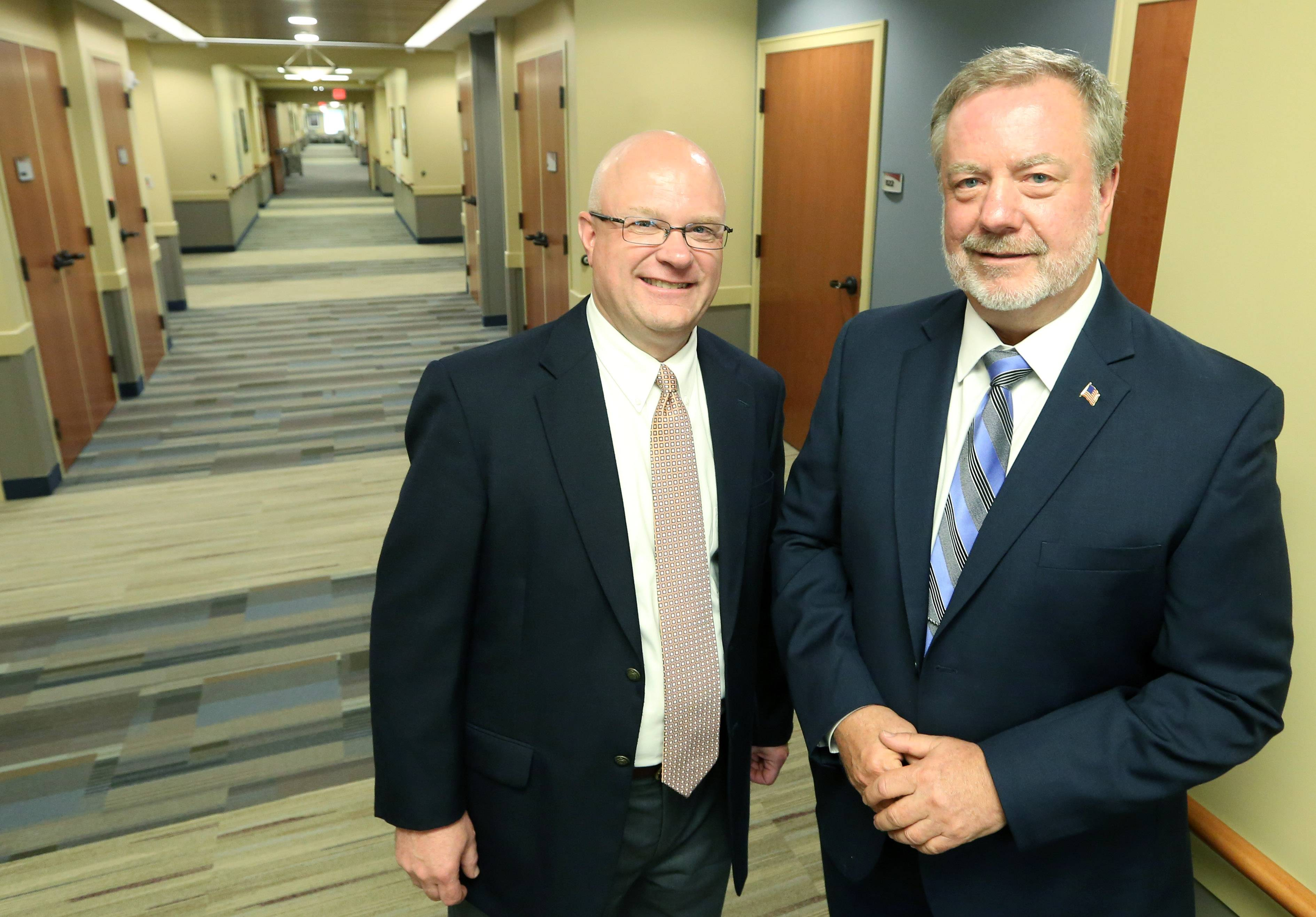 Phil Hemmer, administrator for Lutheran Home, left, and Roger Paulsberg, president and CEO of Lutheran Life Communities, in the patient room hallway at Lutheran Home's new MyRehab Center in Arlington Heights.