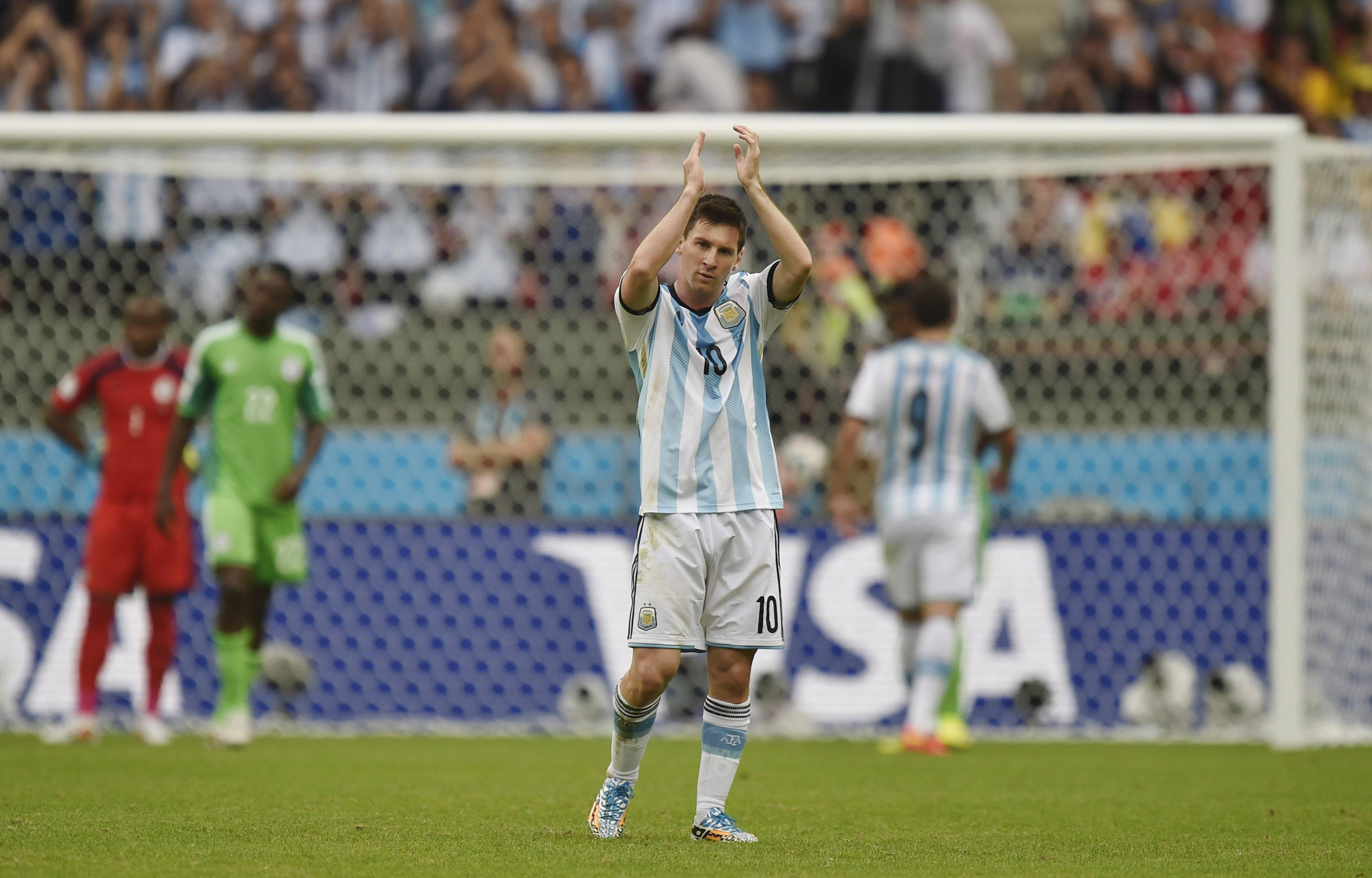 Argentina's Lionel Messi applauds Wednesday after being replaced after scoring two goals for his side during a Group F World Cup match against Nigeria at the Estadio Beira-Rio in Porto Alegre, Brazil.