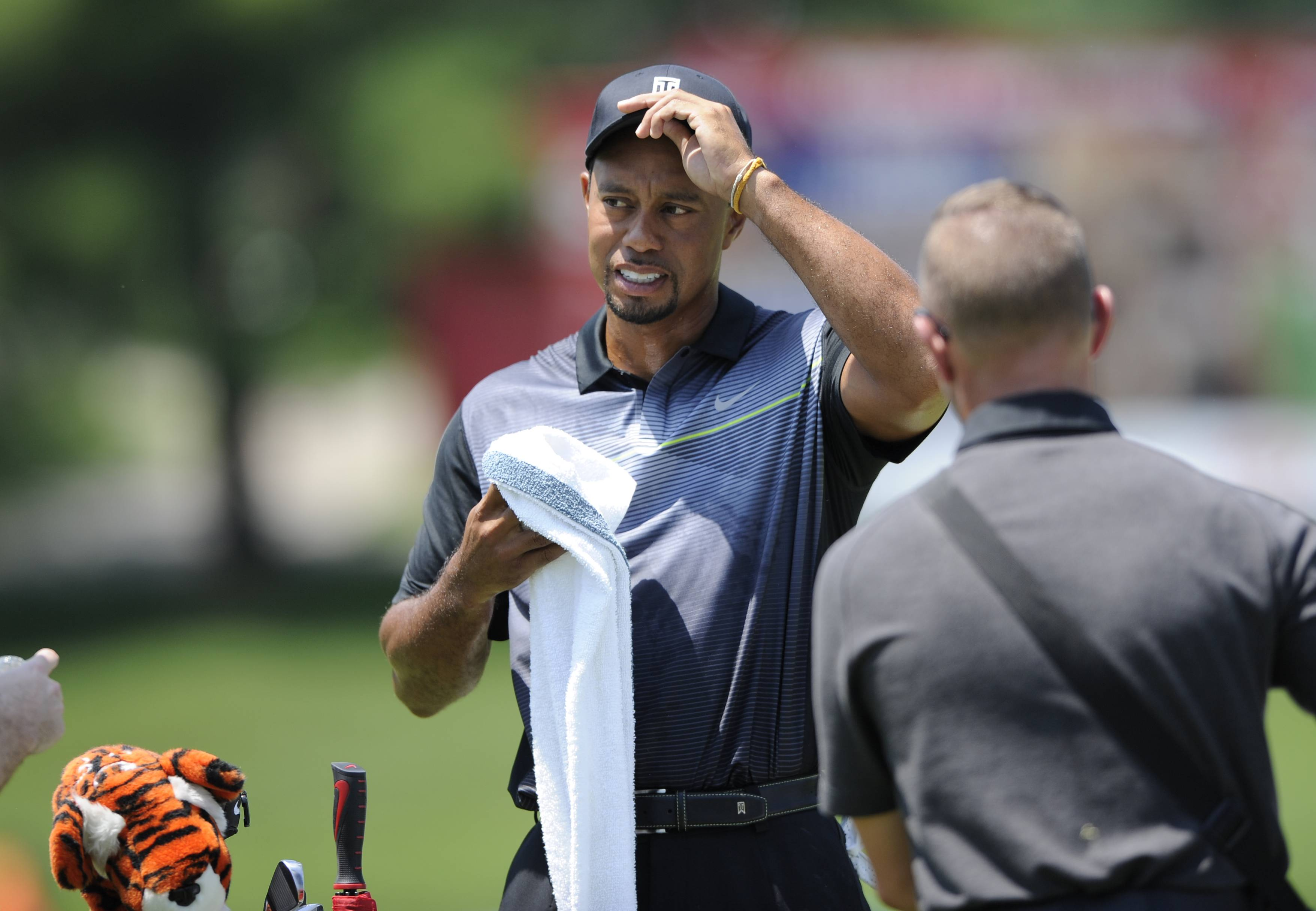 Tiger Woods was back in action Tuesday as he practiced at the Quicken Loans National golf tournament in Bethesda, Md.