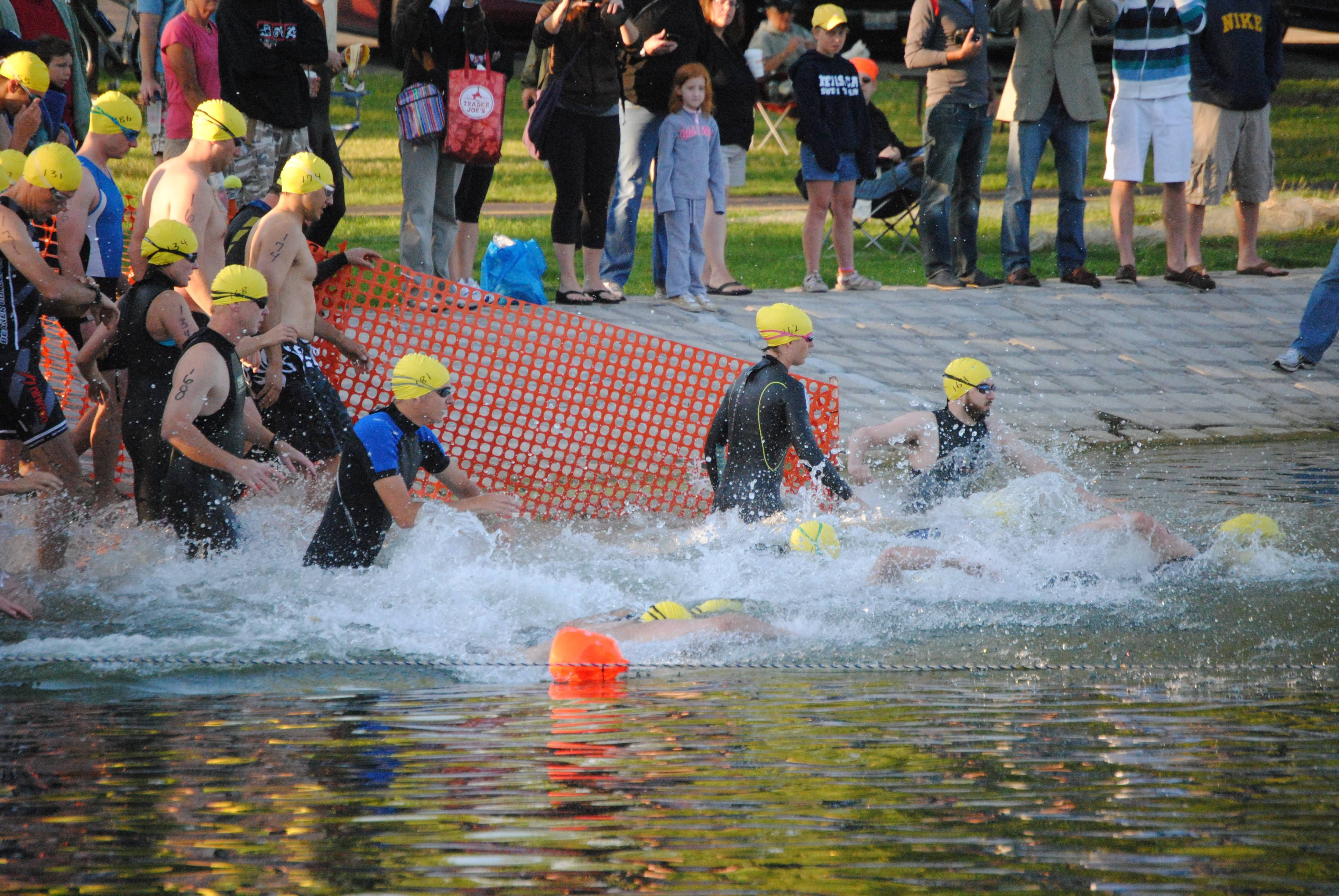 Triathletes jump into the water at Twin Lakes, the first leg of the 2013 triathlon.