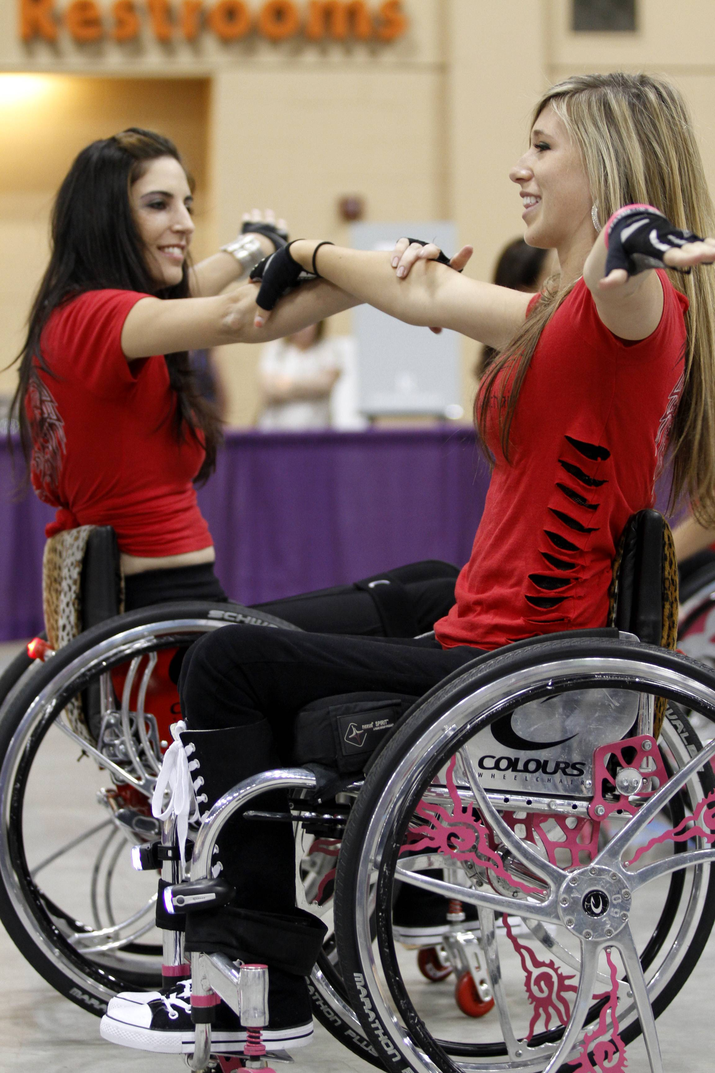 Chelsie Hill, right, from Monterey, California, and Mia Schailkewitz, from North Hollywood, California, perform a dance routine at the 2011 Abilities Expo in Schaumburg. They were part of a wheelchair dance crew called Colors in Motion.