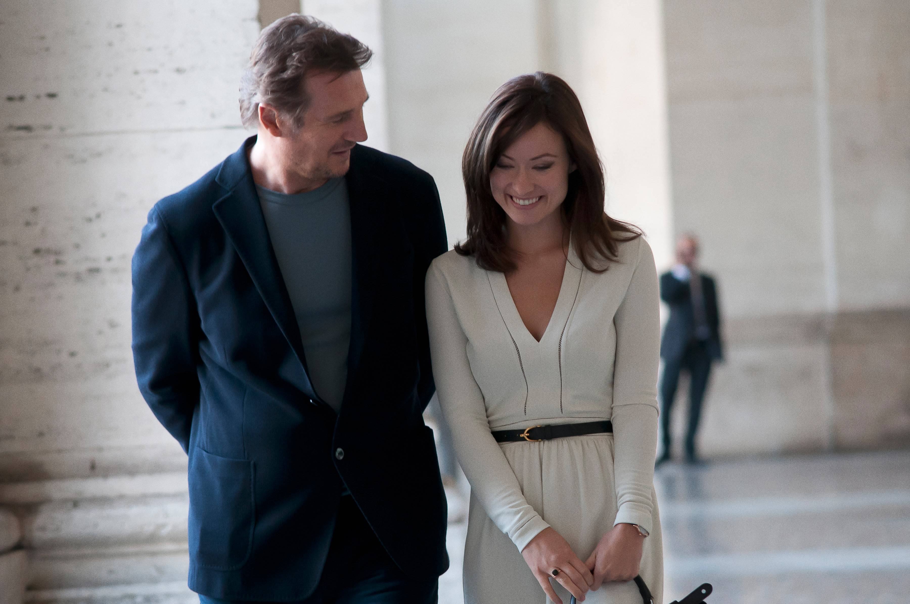 "Michael (Liam Neeson) shares a flirtatious moment with Anna (Olivia Wilde) in Paul Haggis' ambitious drama ""Third Person."""